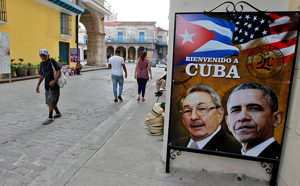 A man walks next to a banner with the faces of Barack Obama and Raul Castro as Cuba prepares for the visit of U.S. president Barack Obama on March 19, 2016 in Havana, Cuba. Obama's visit on March 20 - 22 will be the first in 90 years for a sitting American president. Mastrafoto/CON—LatinContent/Getty Images