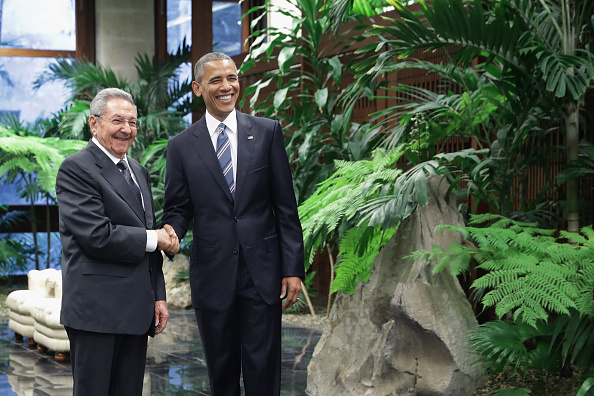 U.S. President Barack Obama (R) and Cuban President Raul Castro pose for photographs after greeting one another at the Palace of the Revolution March 21, 2016 in Havana, Cuba. The first sitting U.S. president to visit Cuba in 88 years, Obama and Castro will sit down for bilateral talks and will deliver joint statements to the news media. Chip Somodevilla—Getty Images