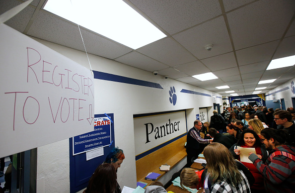 A record number of voters cast ballots at the Democratic caucuses at Farrer Junior High on March 22, 2016 in Provo, Utah.  George Frey—Getty Images