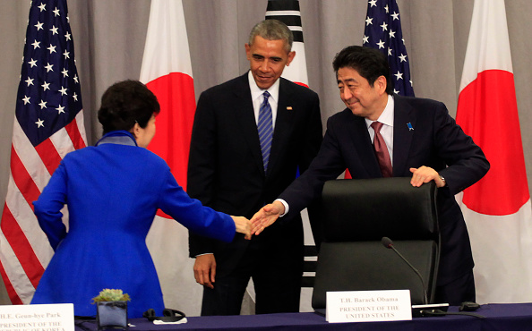 WASHINGTON, DC - MARCH 31: Prime Minister Shinzo Abe of Japan (R) greets President Park Geun-Hye of the Republic of Korea as President Barack Obama looks on during a meeting at the Nuclear Security Summit March 31, 2016 in Washington, DC. World leaders are gathering for a two-day conference that will address a range of issues including ongoing efforts to prevent terrorist groups from accessing nuclear material. (Photo by Dennis Brack-Pool/Getty Images)