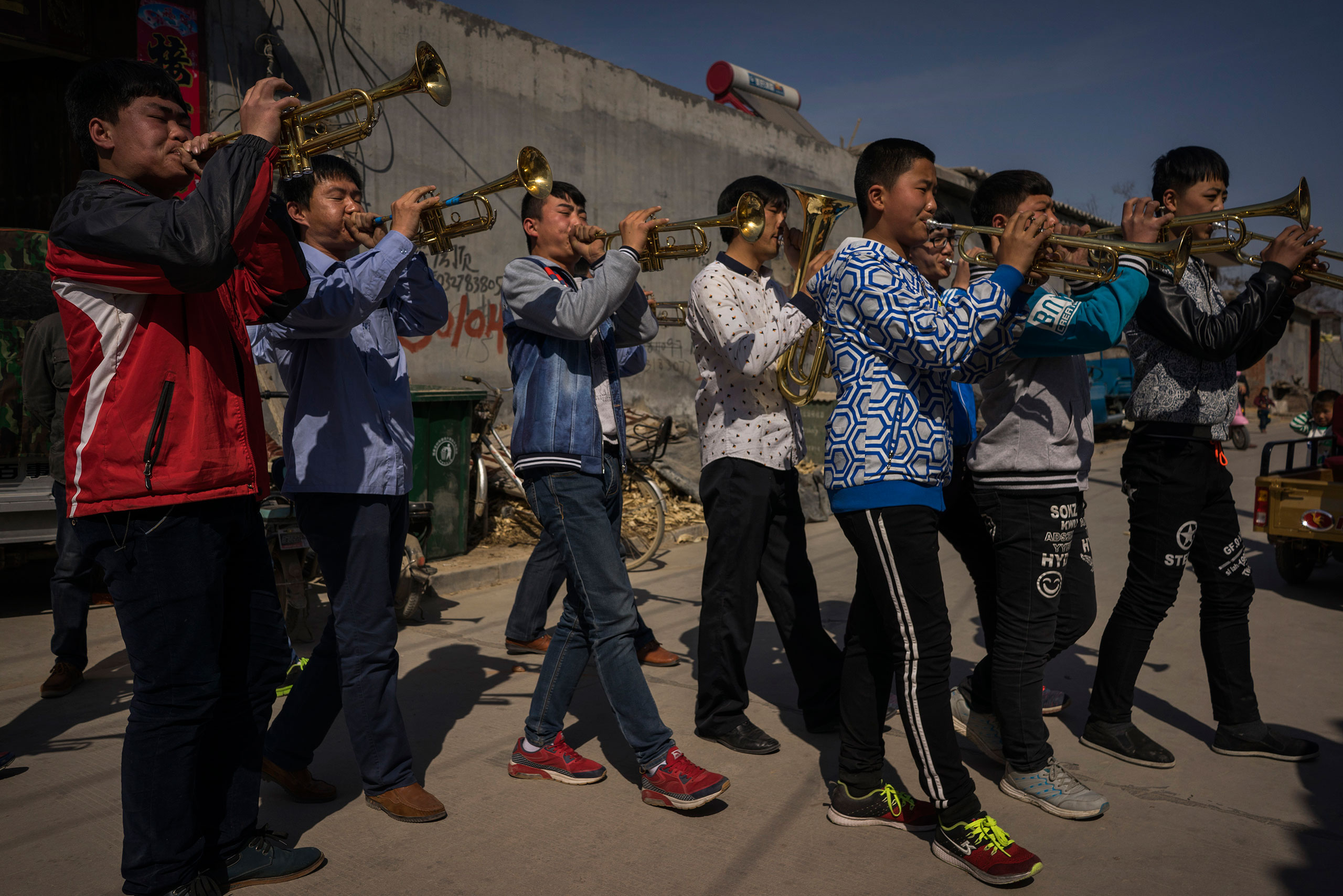 A band plays ahead of an underground Easter Sunday Mass led by dissident Catholic Priest Dong Baolu in the yard of his house in Youtong village, Shijiazhuang, China, March 27, 2016.