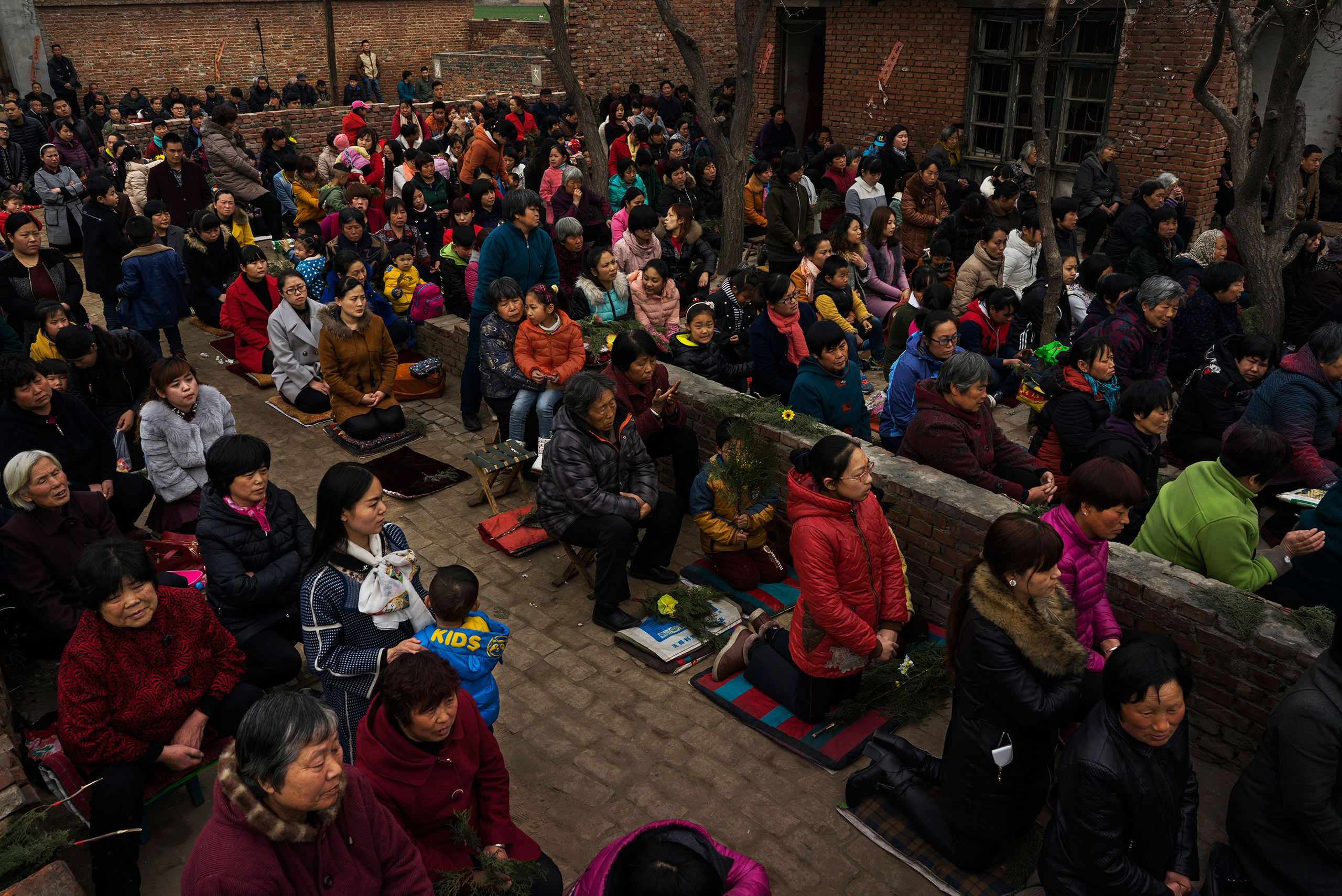 Villagers attend an underground Palm Sunday service in the yard of a rundown house in Youtong village, Shijiazhuang, China, March 20, 2016.