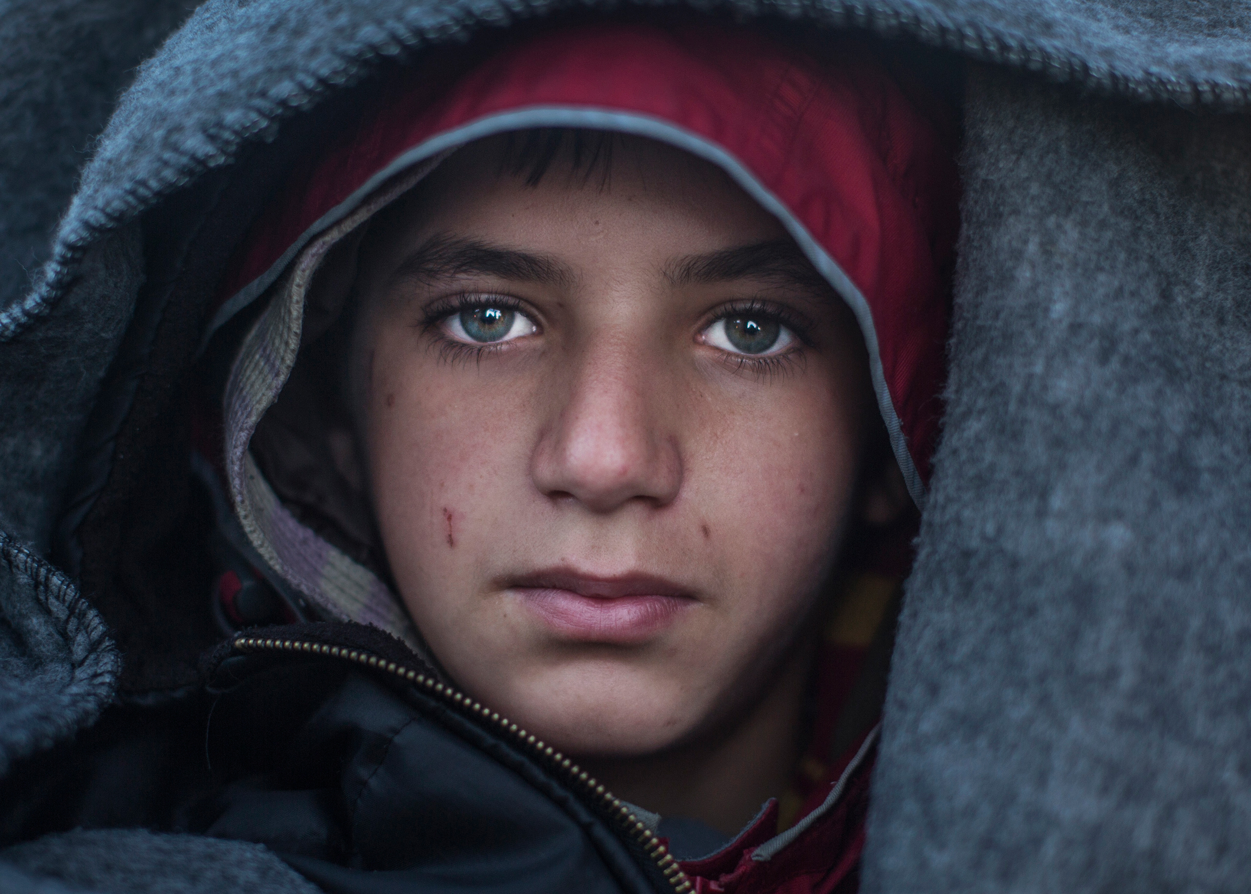 An 11-year-old Syrian refugee named Ahmed waits in line for a map directing asylum-seekers north at an encampment near the Greek village of Idomeni, March 4, 2016.