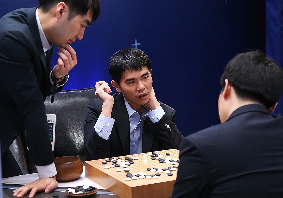 In this handout image provided by Google, South Korean professional Go player Lee Se-Dol reviews the match with other professional Go players after the fourth match against Google's artificial intelligence program, AlphaGo, during the Google DeepMind Challenge Match in Seoul, South Koreaon March 13, 2016.