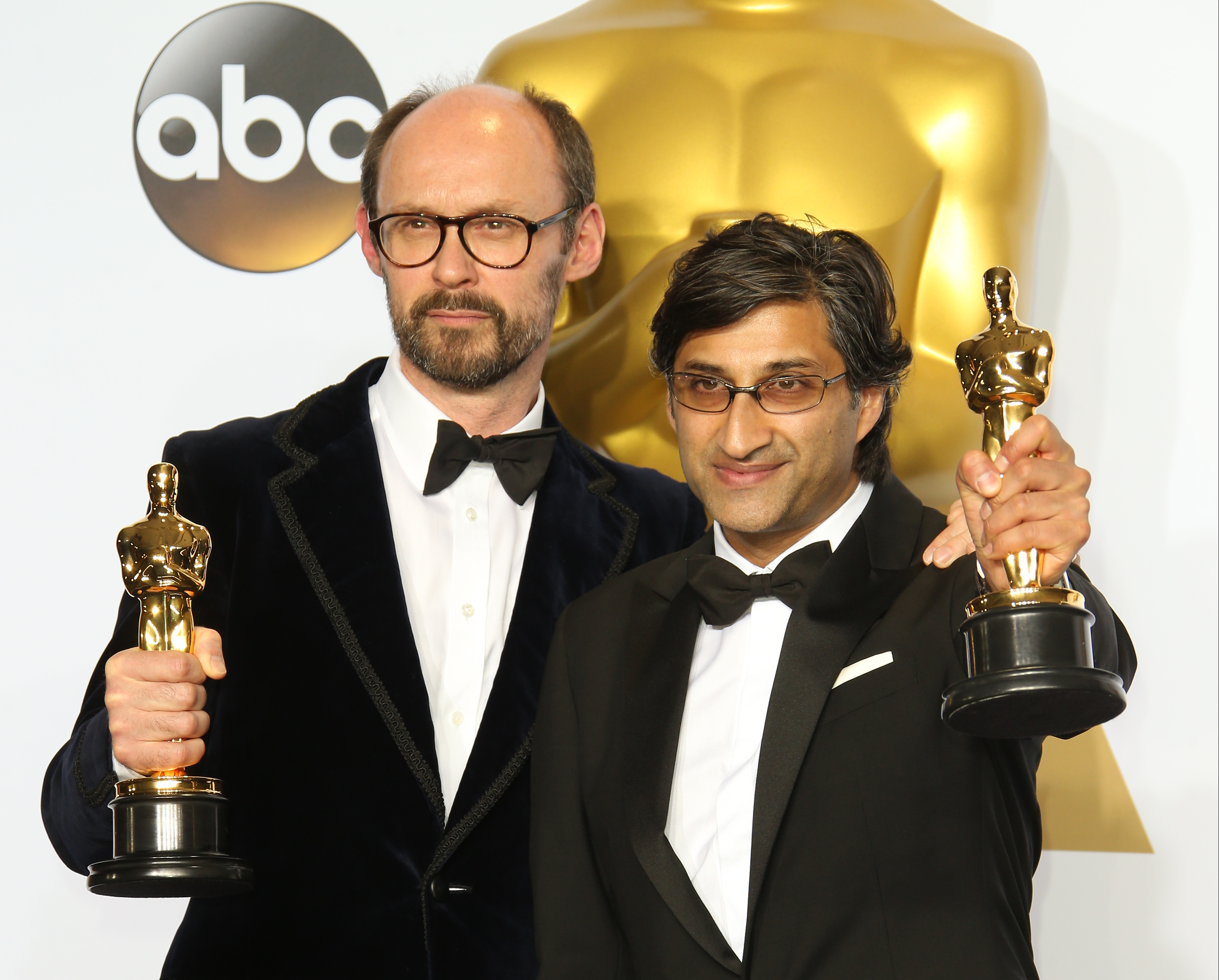 (L-R) James Gay-Rees and Asif Kapadia, winners for Best Documentary Feature for 'Amy,' pose in the press room at the 88th Annual Academy Awards at Hollywood & Highland Center on February 28, 2016 in Hollywood, California.