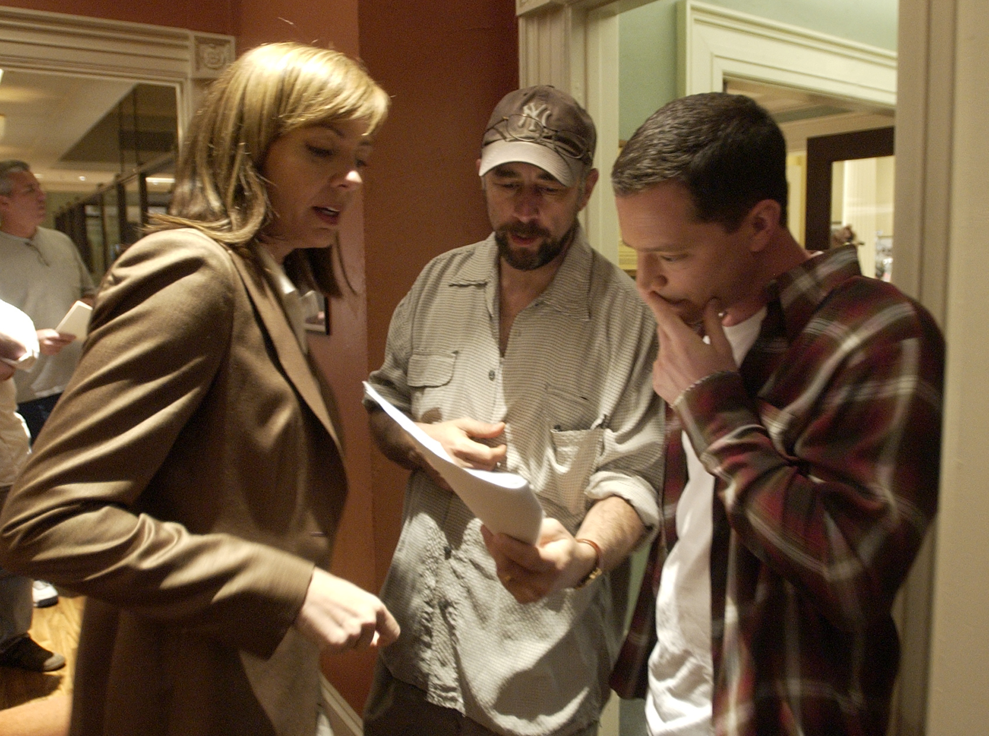Actors Josh Malina, right, who plays White House aide Will Bailey on NBC's   The West Wing,  goes over a scene with cast members Allison Janney, and Richard Schiff during filming in Burbank, Calif., March 10, 2004.