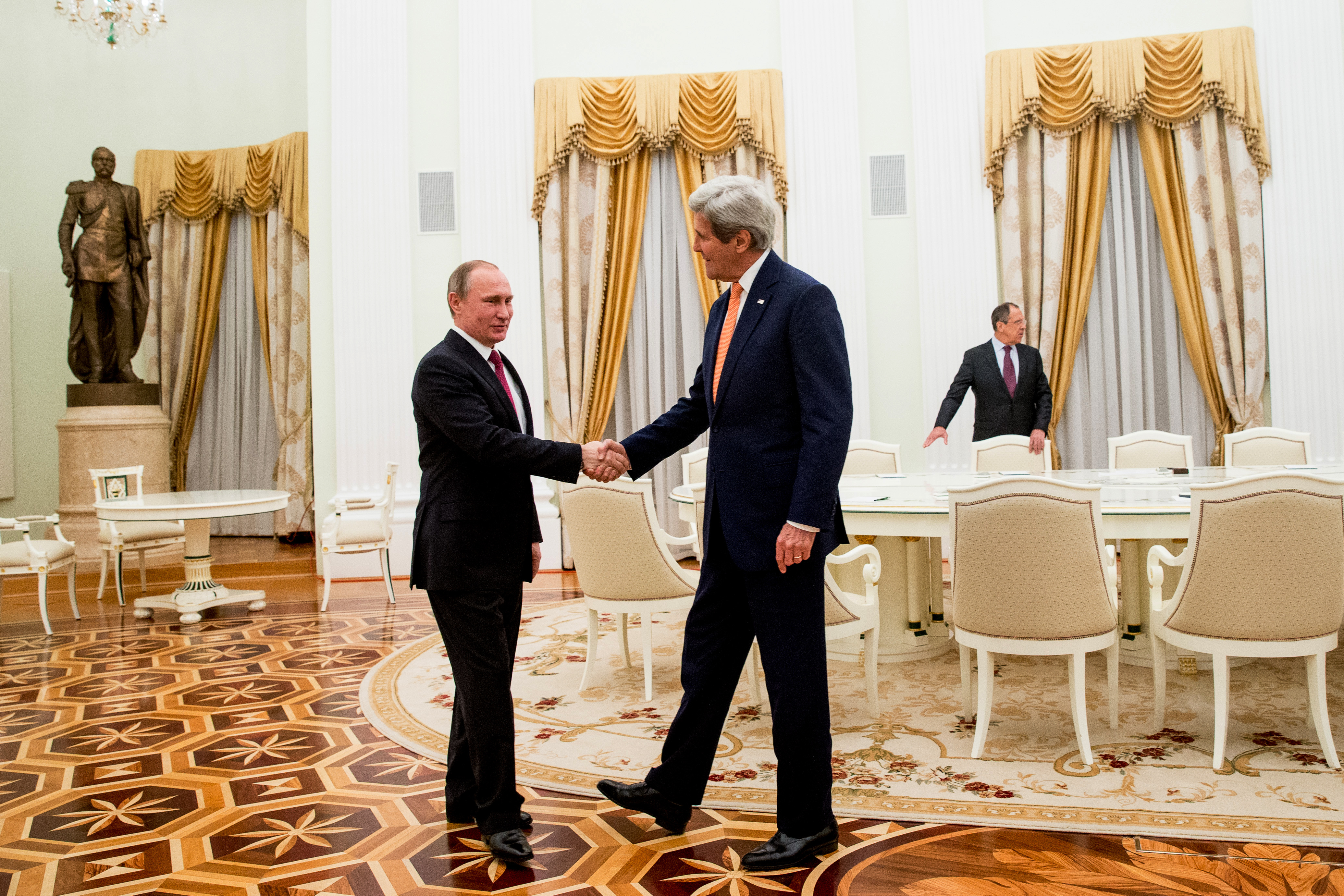 U.S. Secretary of State John Kerry shakes hands with Russian President Vladimir Putin before their meeting at the Kremlin in Moscow on March 24, 2016