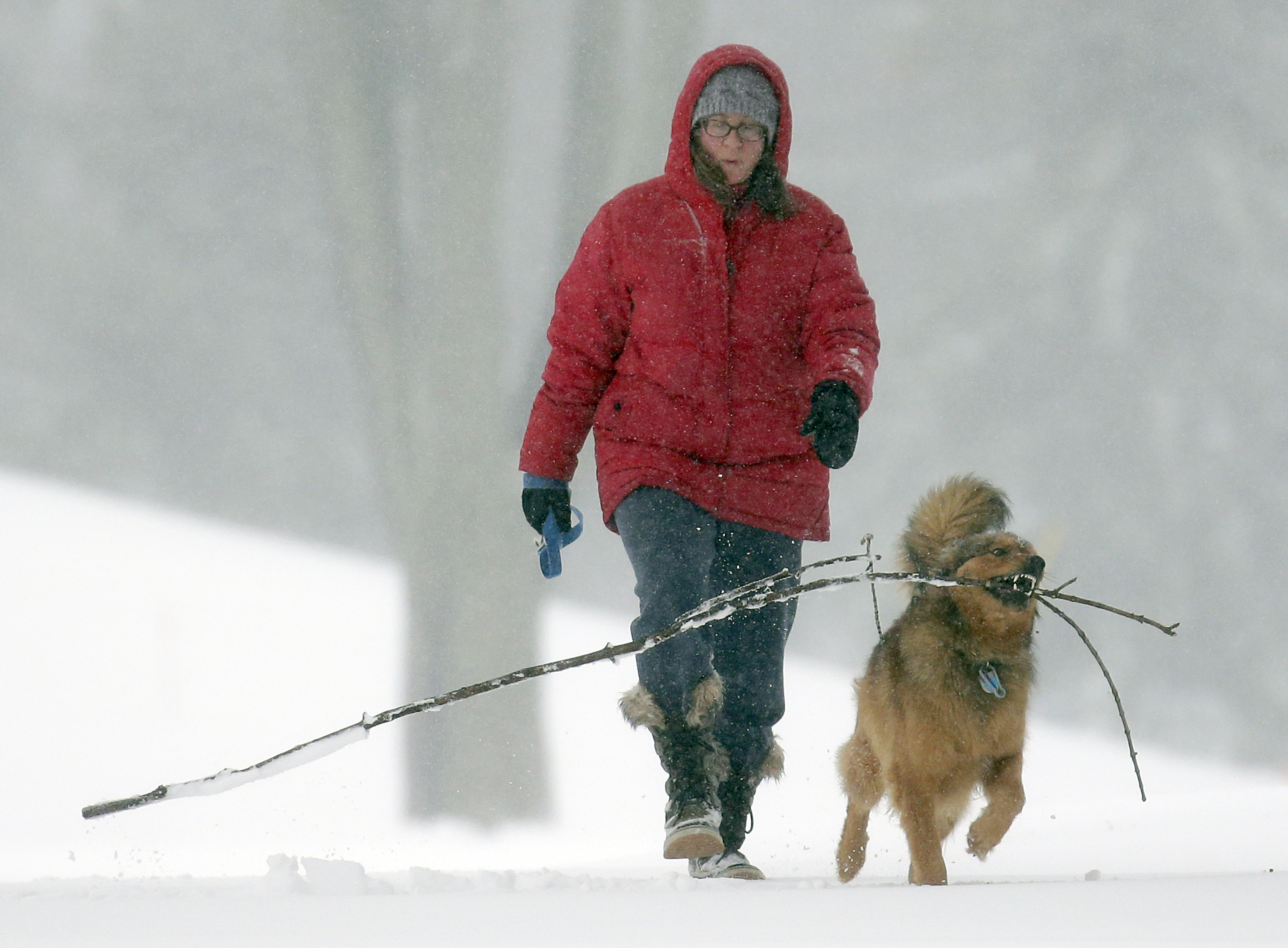 Rebecca Martin and her dog Norris on their daily walk through Erb Park  March 24, 2016, in Appleton, Wis.