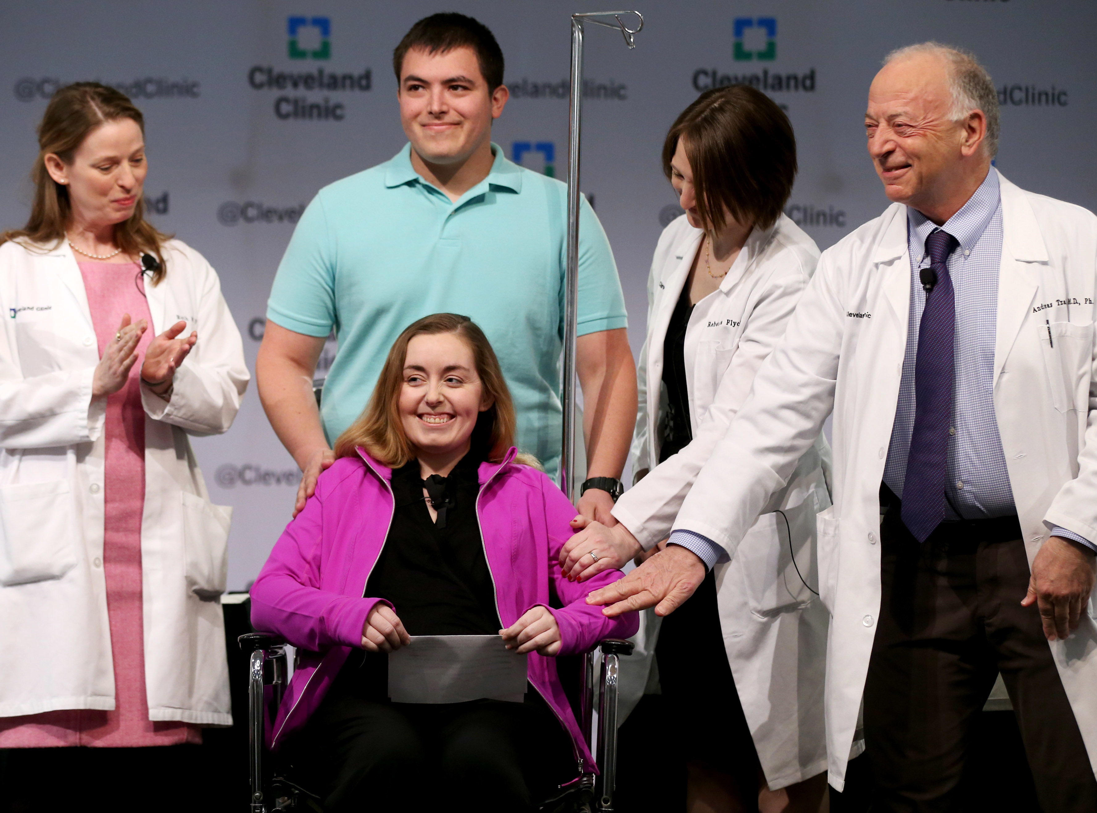Lindsey and her husband Blake stand with Cleveland Clinic medical staff as they announce she was the nation's first uterus transplant patient, March 7, 2016, in Cleveland, Ohio