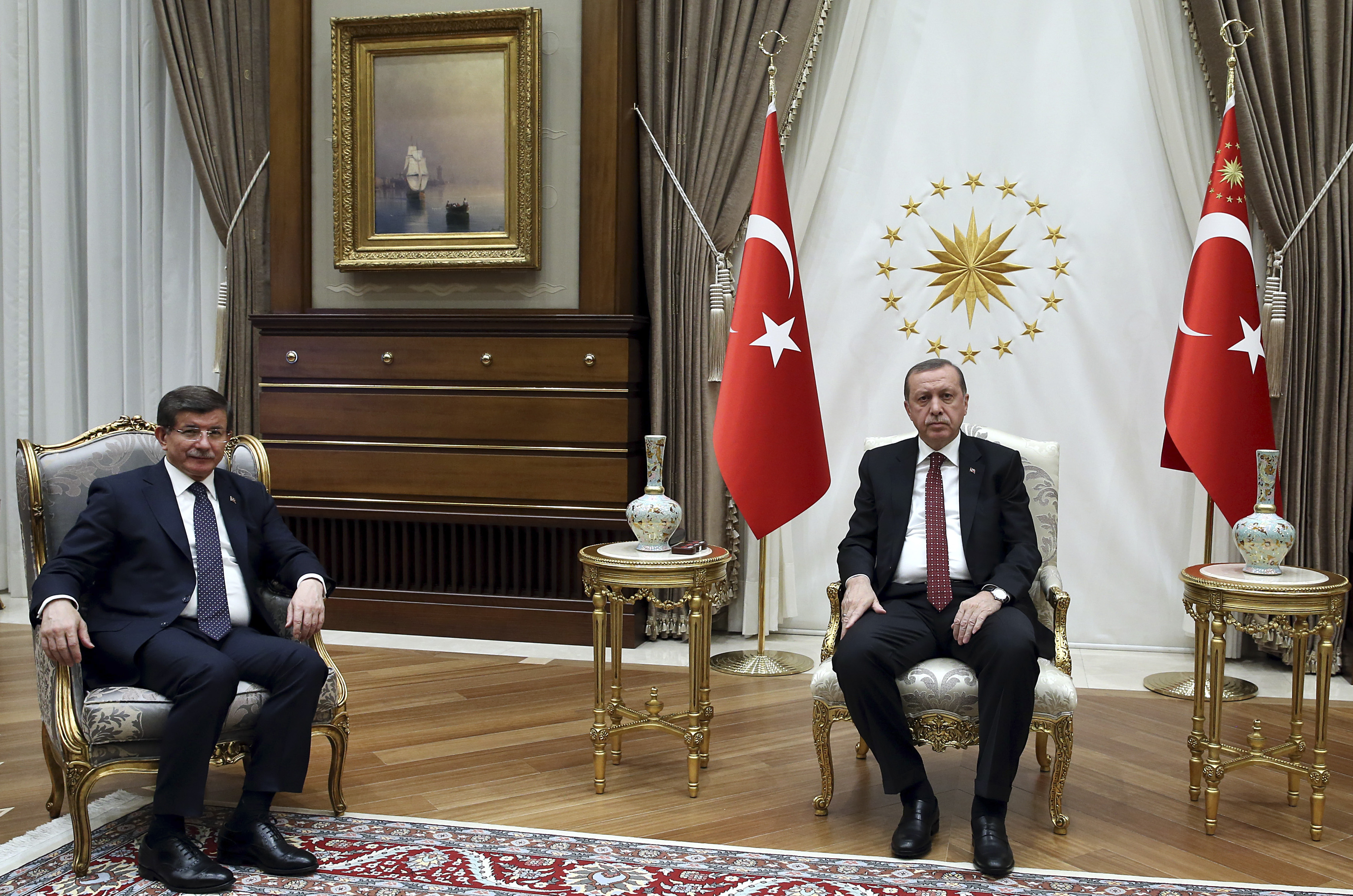 Turkey's President Recep Tayyip Erdogan, right, meets with Turkey's Prime Minister Ahmet Davutoglu, left, in Ankara, Turkey, to discuss Sunday's explosion in the capital, Monday, March 14, 2016