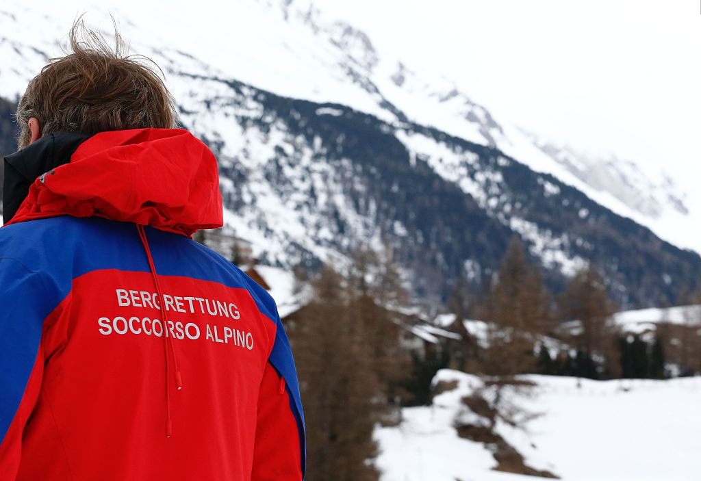 A member of the mountain rescue team stands at the end of the operations after an avalanche close to Riva di Tures, on March 12, 2016.