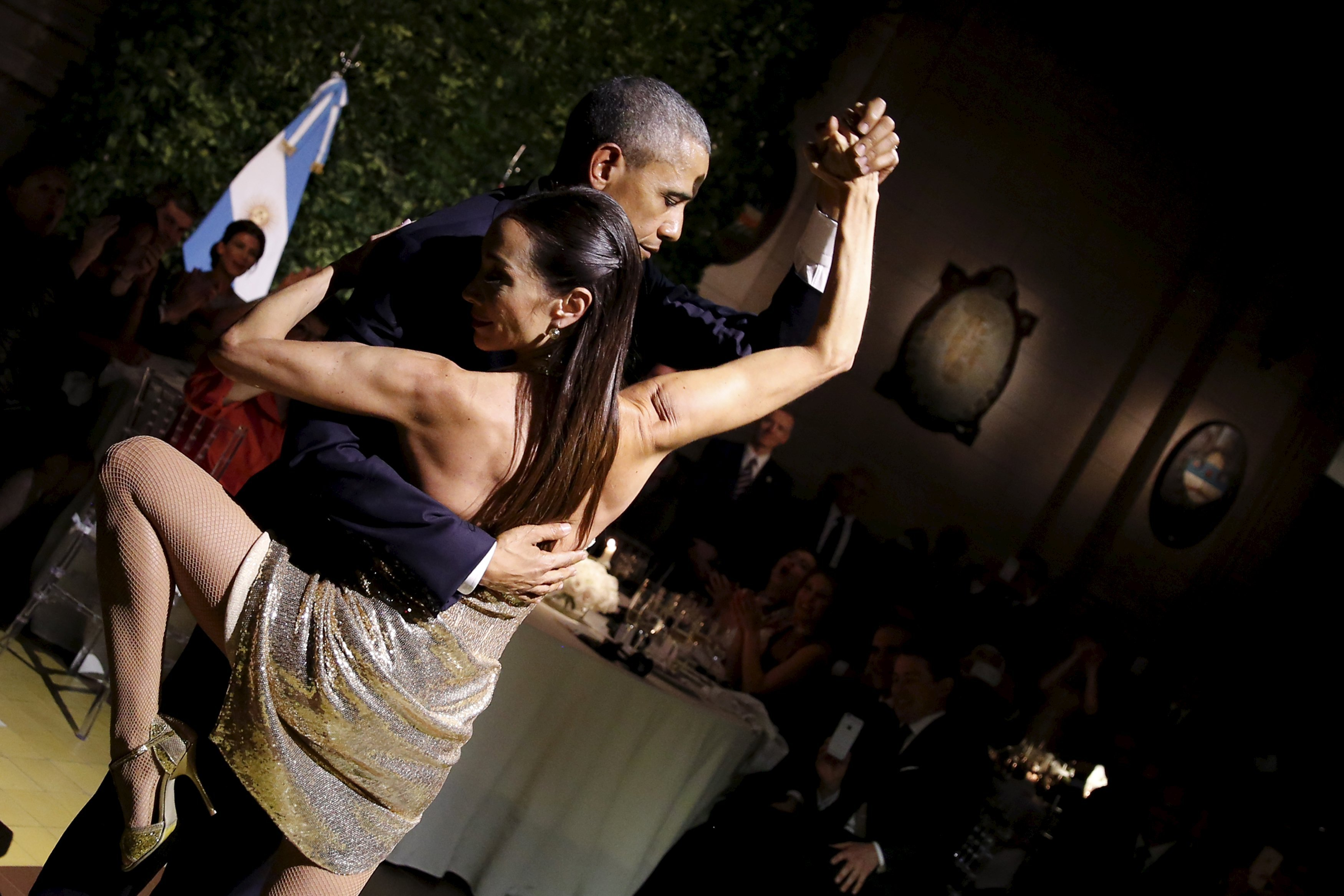 U.S. President Barack Obama dances tango during a state dinner hosted by Argentina's President Mauricio Macri at the Centro Cultural Kirchner as part of President Obama's two-day visit to Argentina, in Buenos Aires on March 23, 2016.