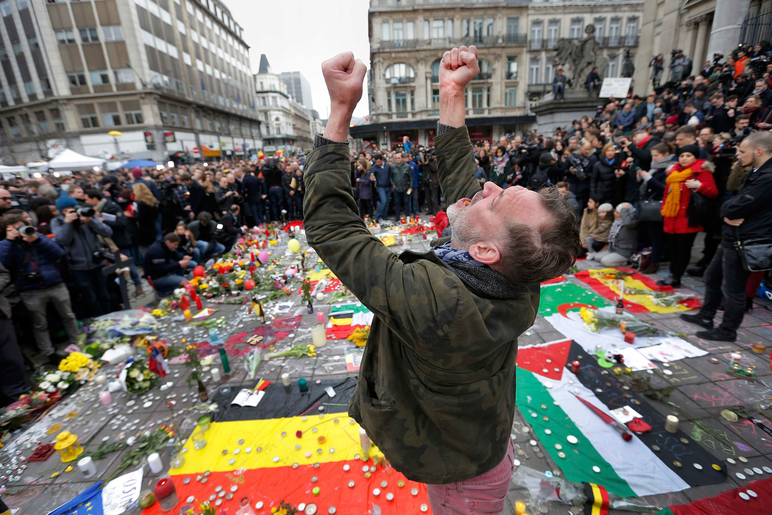 A man reacts at a street memorial following Tuesday's bomb attacks in Brussels, Belgium, March 23, 2016.