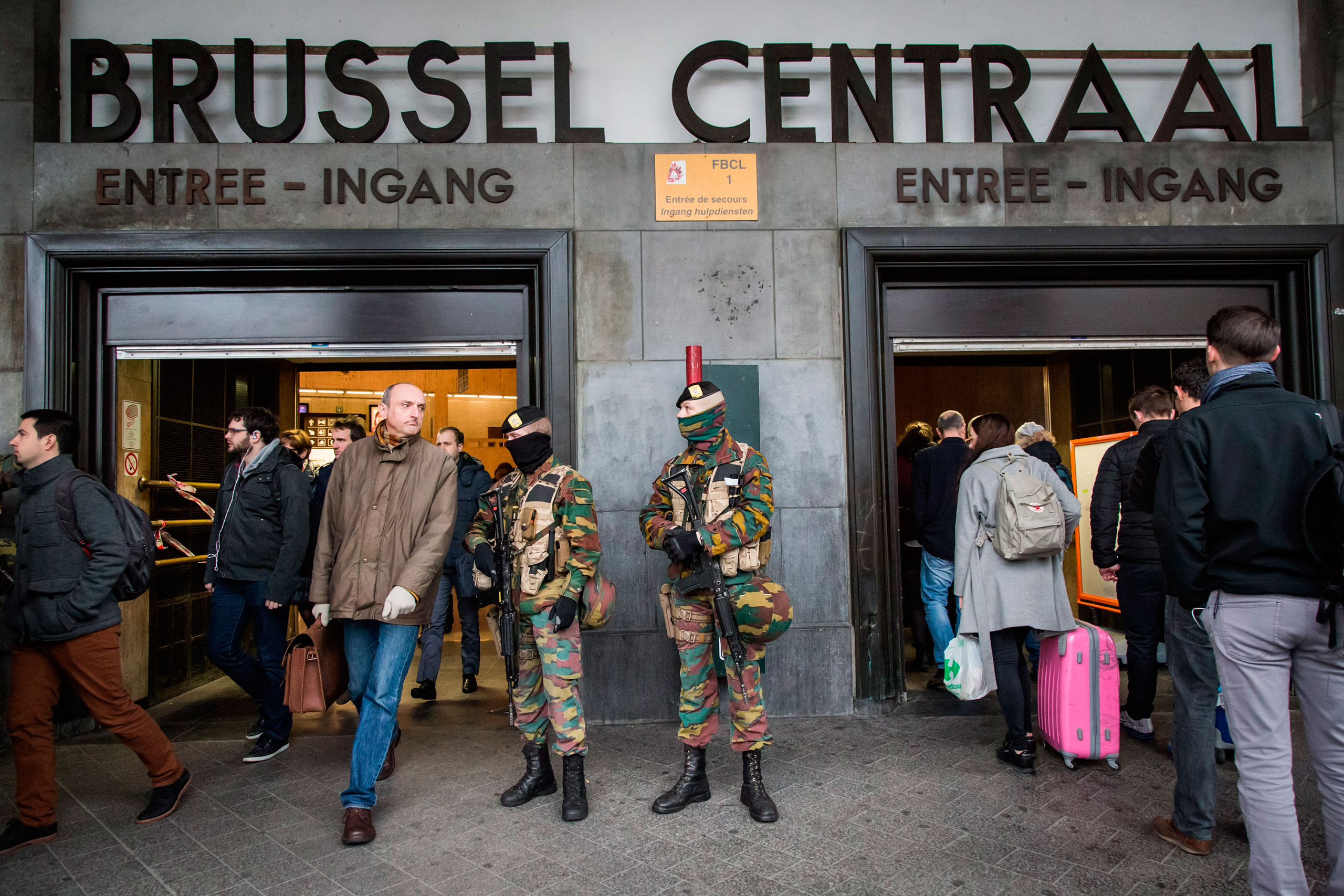 Soldiers stand guard at the entrance of Brussels Central Station, on March 23, 2016, one day after the terrorist attacks killed at least 31 people