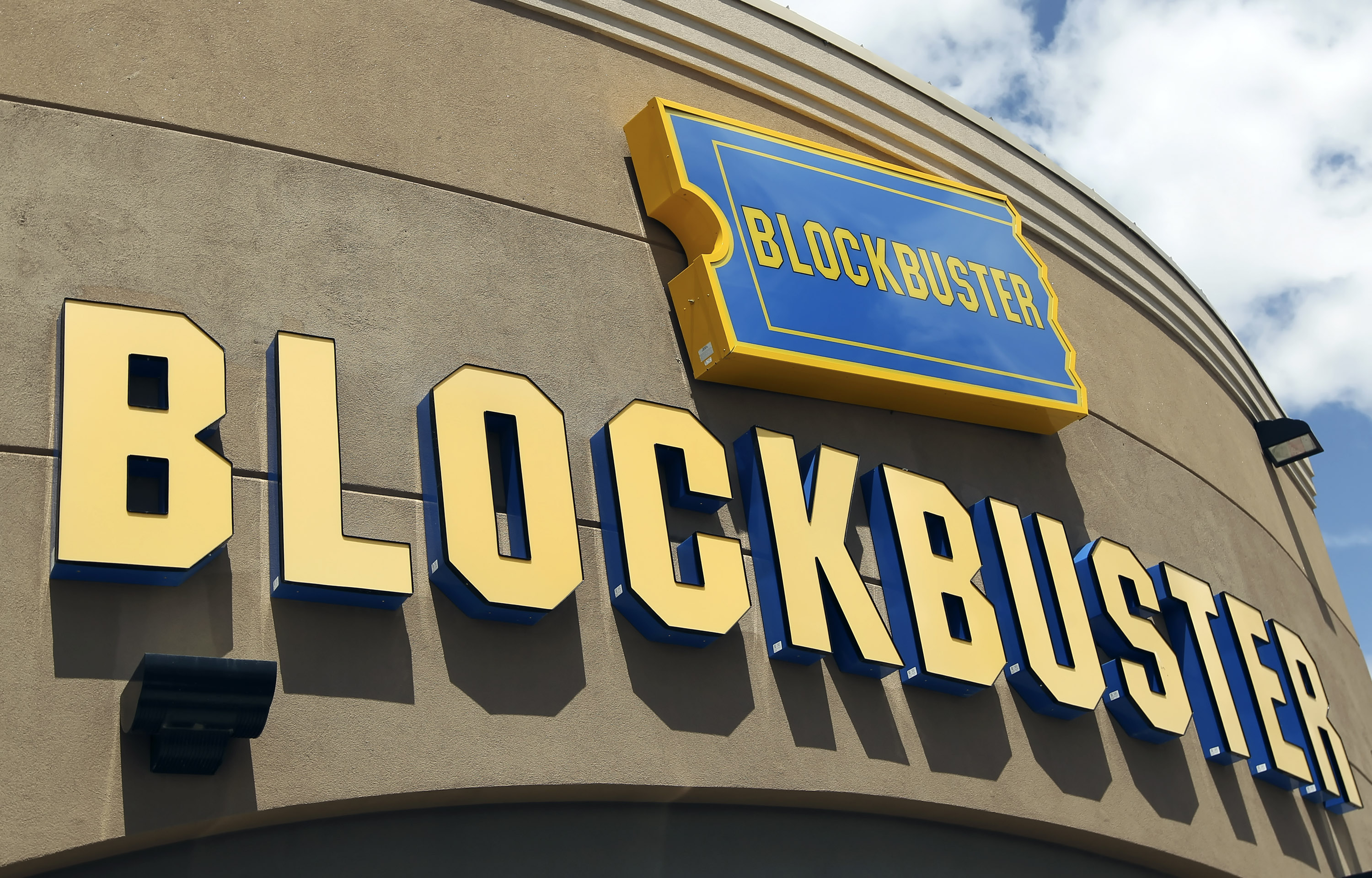 Signage hangs outside a Blockbuster store in Salt Lake City, Utah, U.S., on Wednesday, May 12, 2010.
