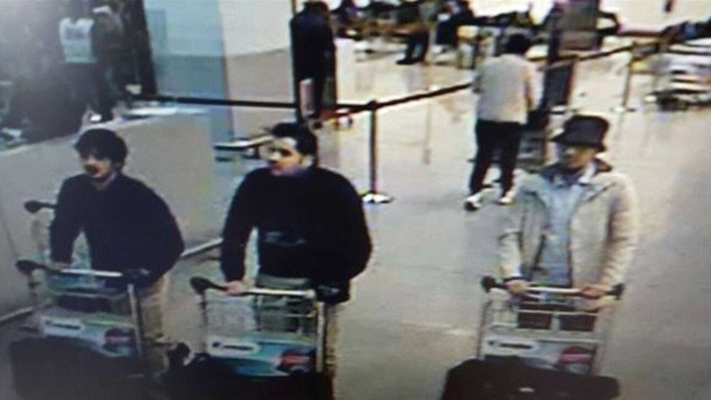 This image provided by the Belgian Federal Police in Brussels on Tuesday, March 22, 2016 shows men who are suspected of taking part in the attacks at Belgium's Zaventem Airport. The man at right is still being sought by the police and two others in the photo that the police issued were according to a the Belgian Prosecutors 'probably' suicide bombers.