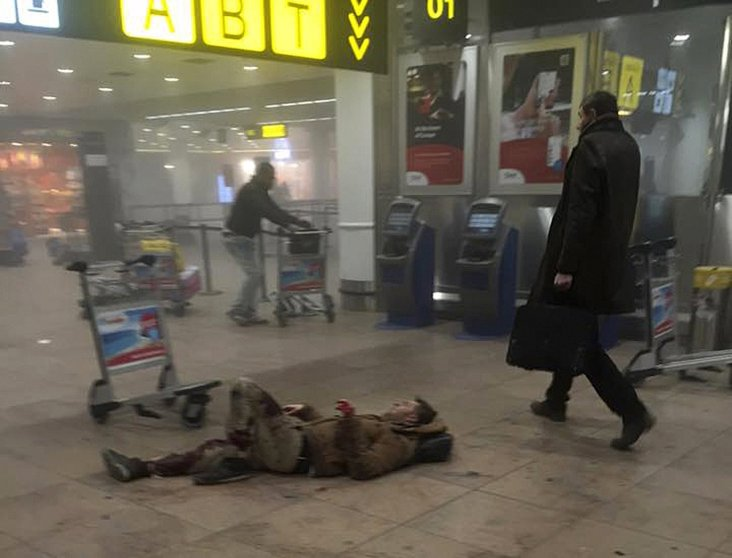 An injured man lies at the scene of explosions at Zaventem airport near Brussels, Belgium, on March 22, 2016.