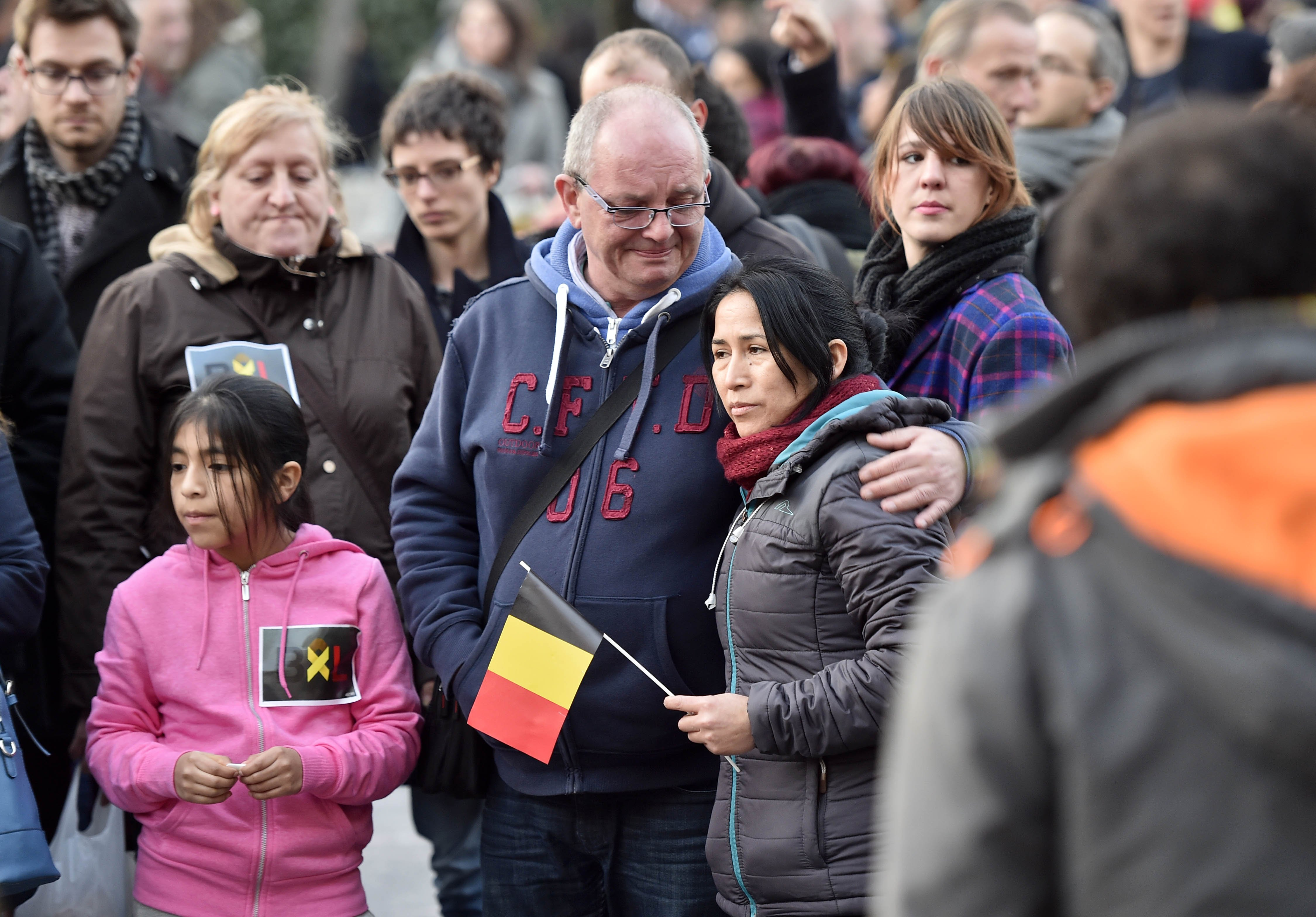 People mourn for the victims at Place de la Bourse in the center of Brussels, on March 22, 2016.
