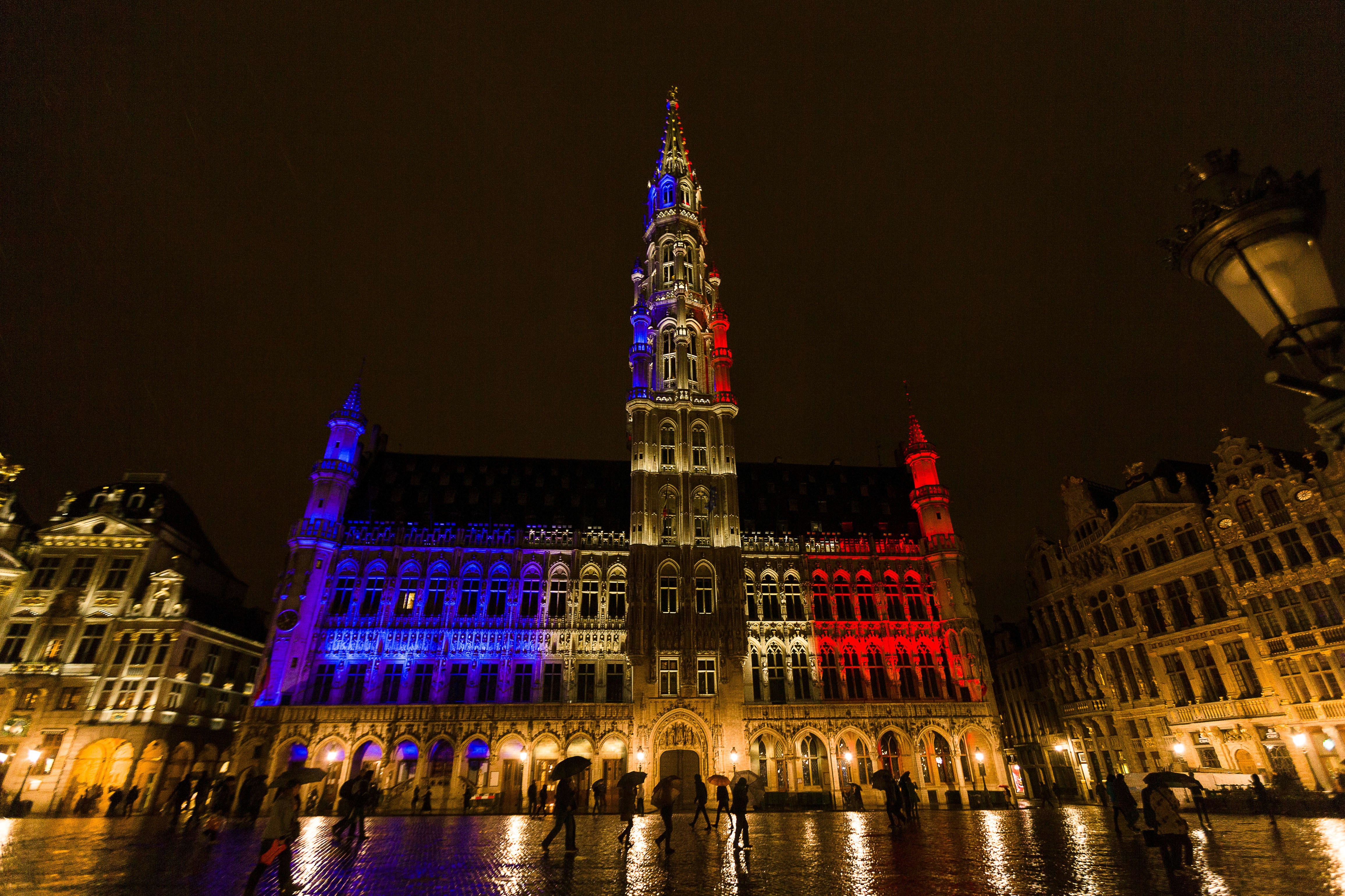 The town hall of Brussels is illuminated with the colors of the French national flag, at the Brussels Grand Place, on Nov. 14, 2015, a day after deadly attacks in Paris.