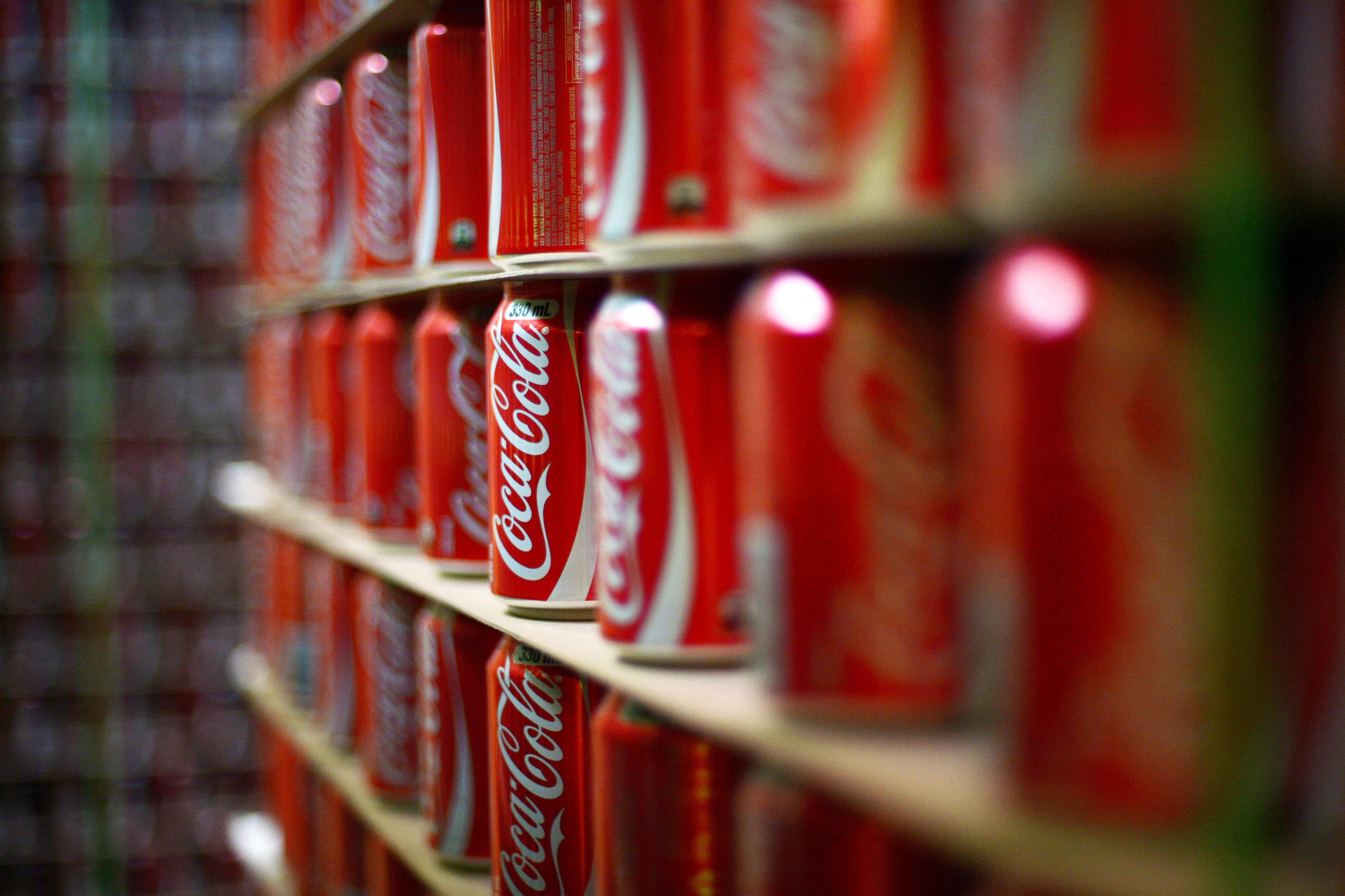 Coca-Cola cans are stacked at a production facility in Melbourne, Australia on Feb. 16, 2016.