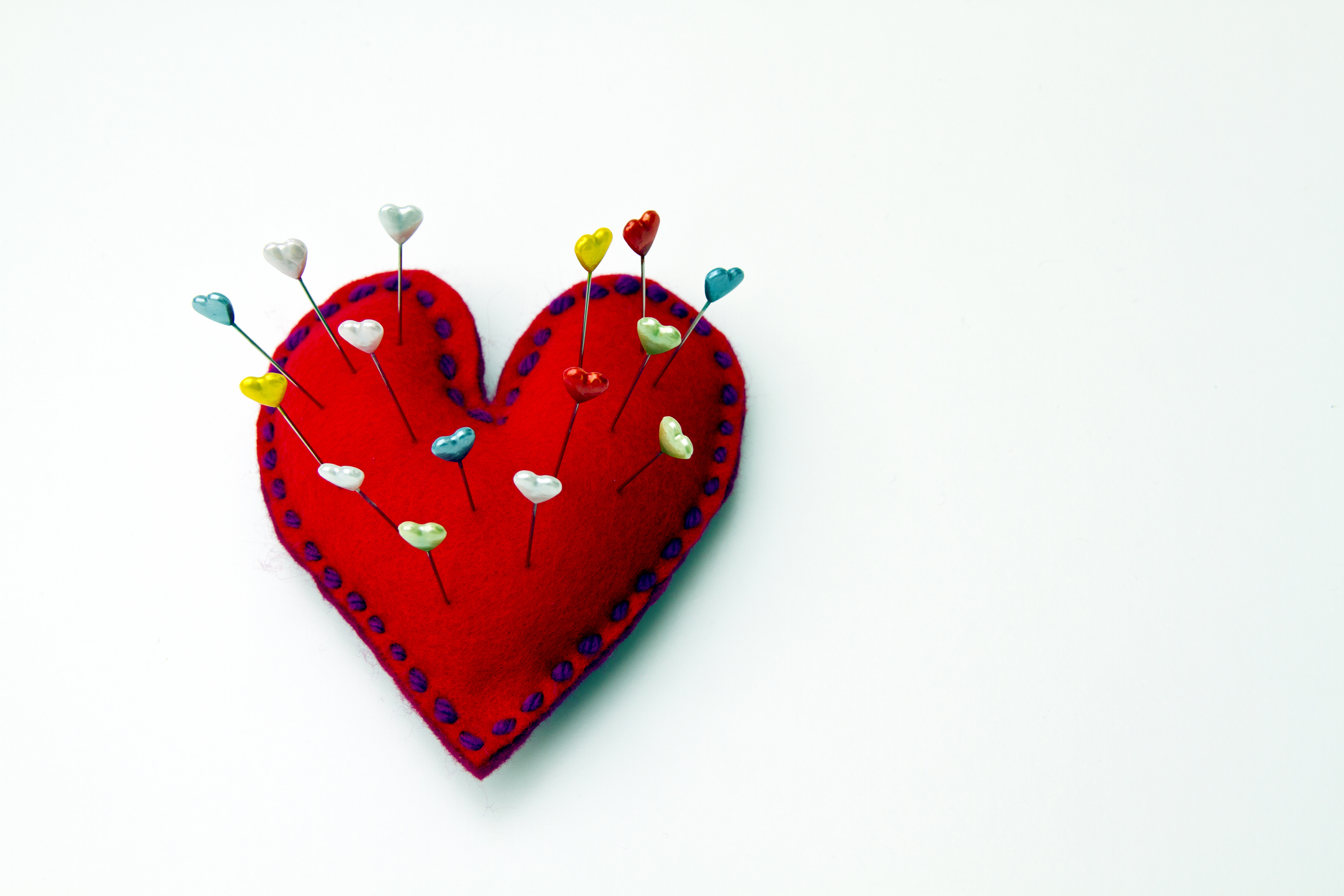 Heart shaped pin cushion with heart pins