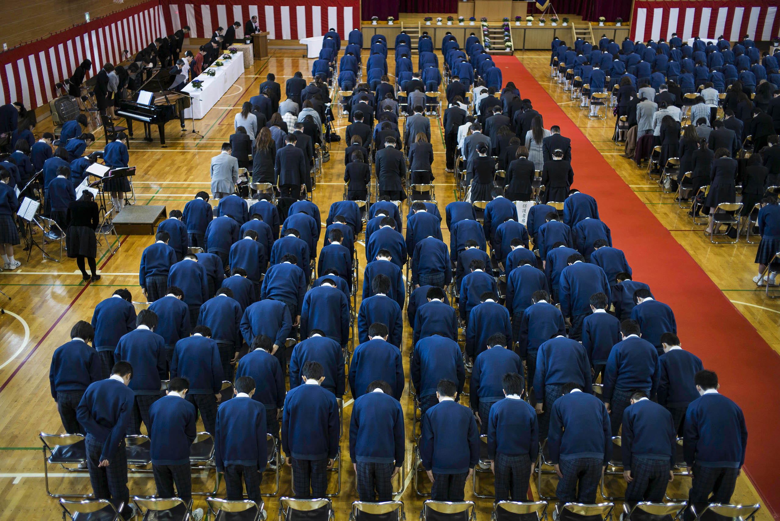 Students in the first rows prepare to graduate from Minamisoma's Ishigami Junior High School on the fifth anniversary of the massive earthquake and tsunami that struck the northeastern coast of Japan, damaging the Fukushima Daiichi nuclear power plant 25km away.