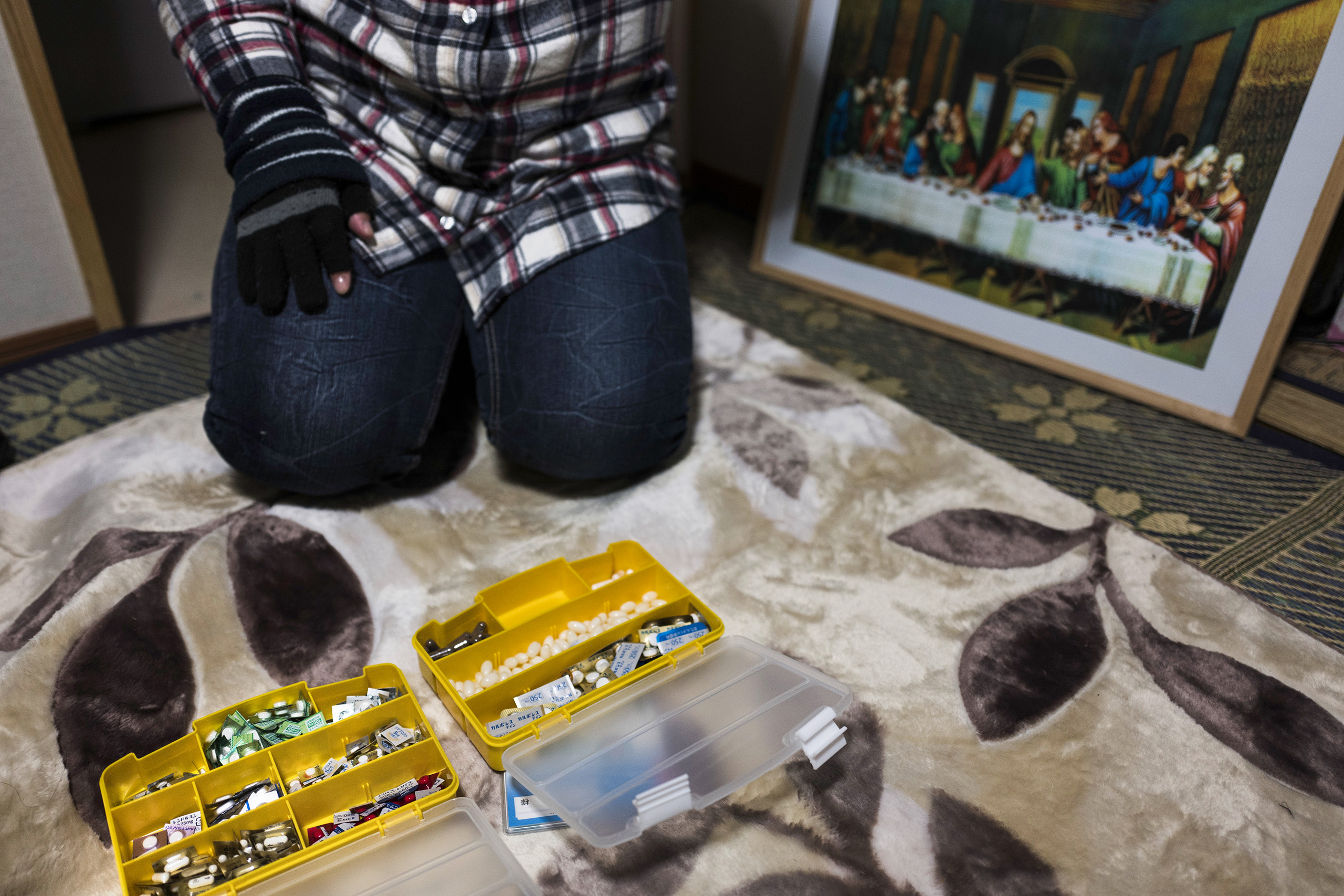 Terumi Murakami, a 43-year-old mother of three children and an evacuee from Okuma, 5km from the Fukushima Daiichi nuclear power plant, shows all the daily pills she takes, Iwaki, Japan, March 4, 2016. Murakami said severe depression and isolation pushed her to attempt suicide in this bedroom on April 5, 2015, after taking two month's worth of prescription drugs for depression. She survived after her children found her and called an ambulance. It was also the first day of school for her youngest daughter.