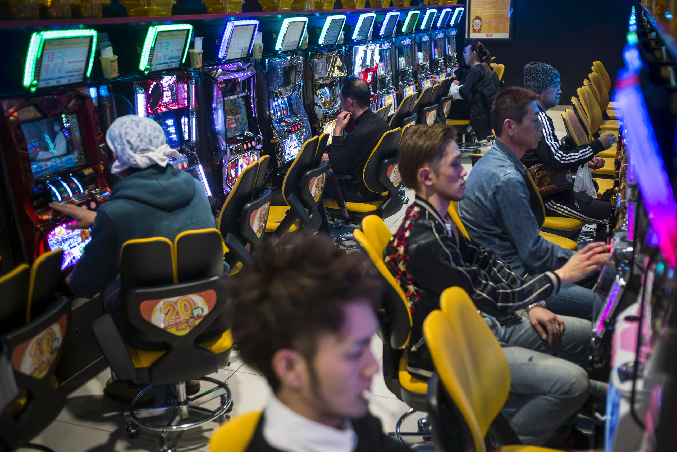 Yuki Mine, a 34-year-old part-time hairdresser and bartender, and other Minamisoma residents enjoy legal gambling in one of the many slot machine arcades, March 6, 2016. Several arcades have opened up in this region due to the high number of decontamination and other workers that have flocked to the town, as well as many residents who have received large amounts of compensation.