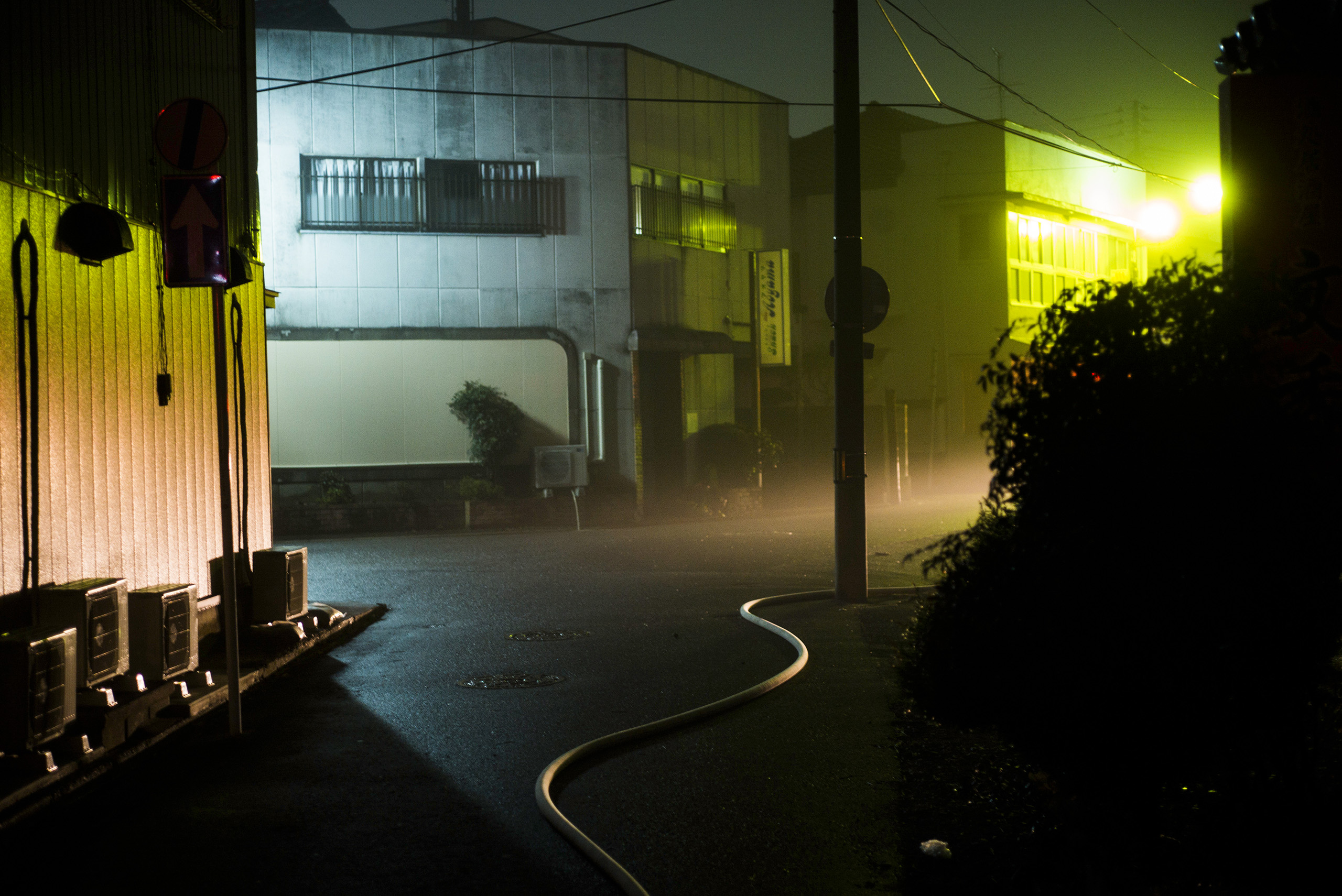 A hose from a fire engine is seen after an incident at a bar in Minamisoma, Fukushima, March 8, 2016.