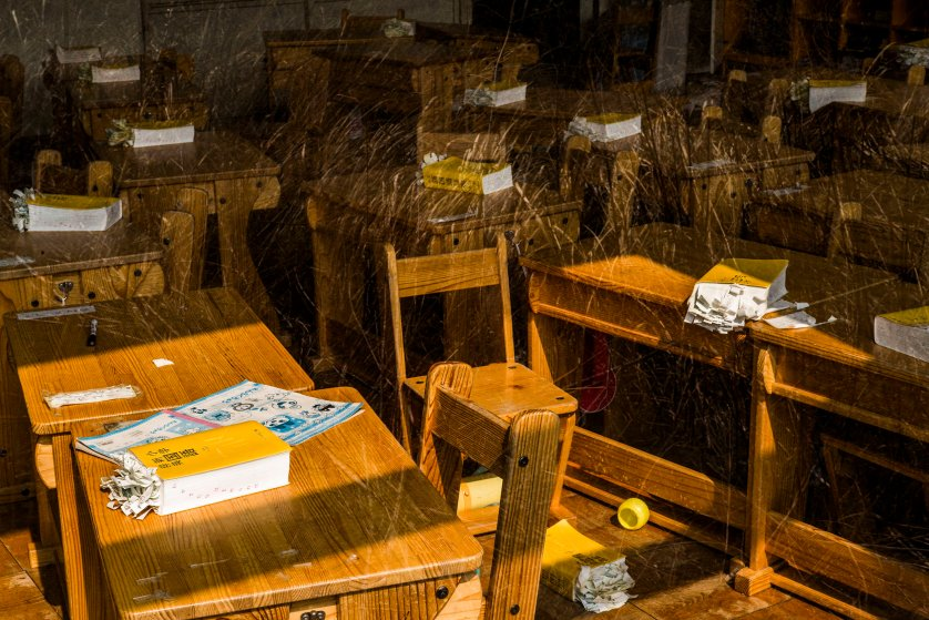 Japanese dictionaries for first-graders remain inside a classroom at the abandoned Kumano Elementary School in Okuma, Japan, March 4, 2016. The school lies within the 5km exclusion zone around the Fukushima Daiichi nuclear power plant.