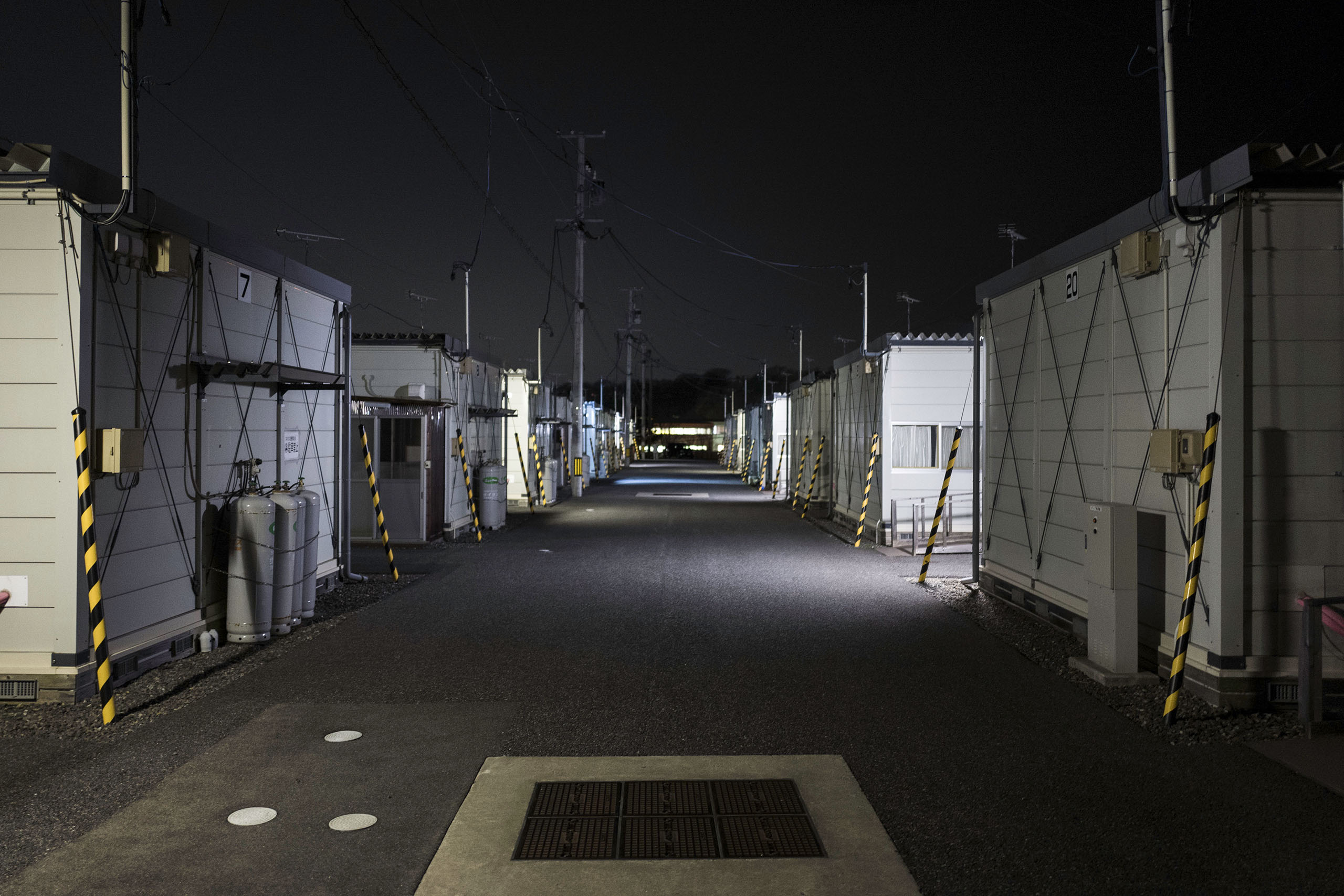 Temporary housing units are seen at night, March 4, 2016.