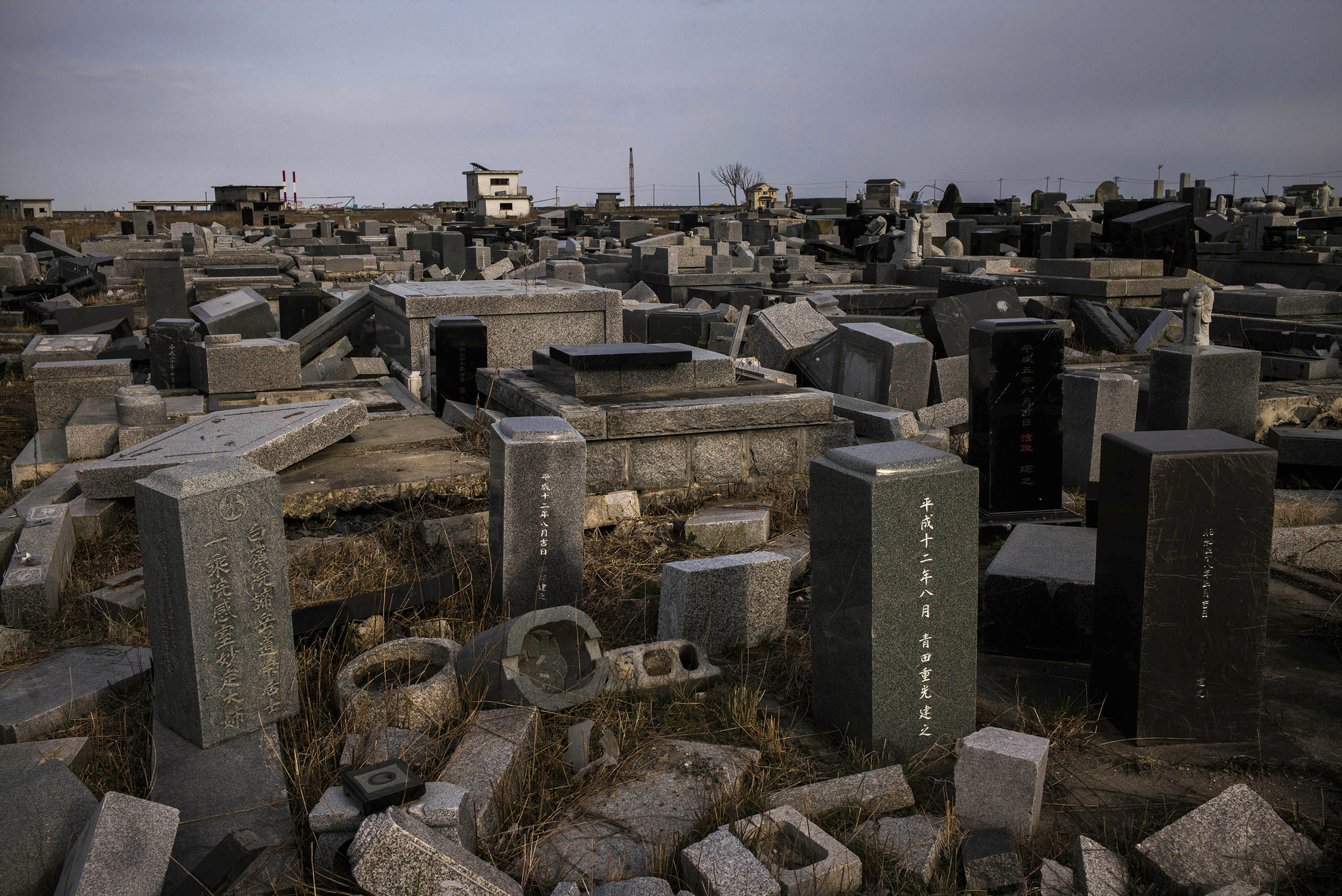 Damaged graves in Namie can be seen on the fifth anniversary of the tsunami that struck on March 11, 2011, after a massive earthquake along the northeastern coast of Japan.
