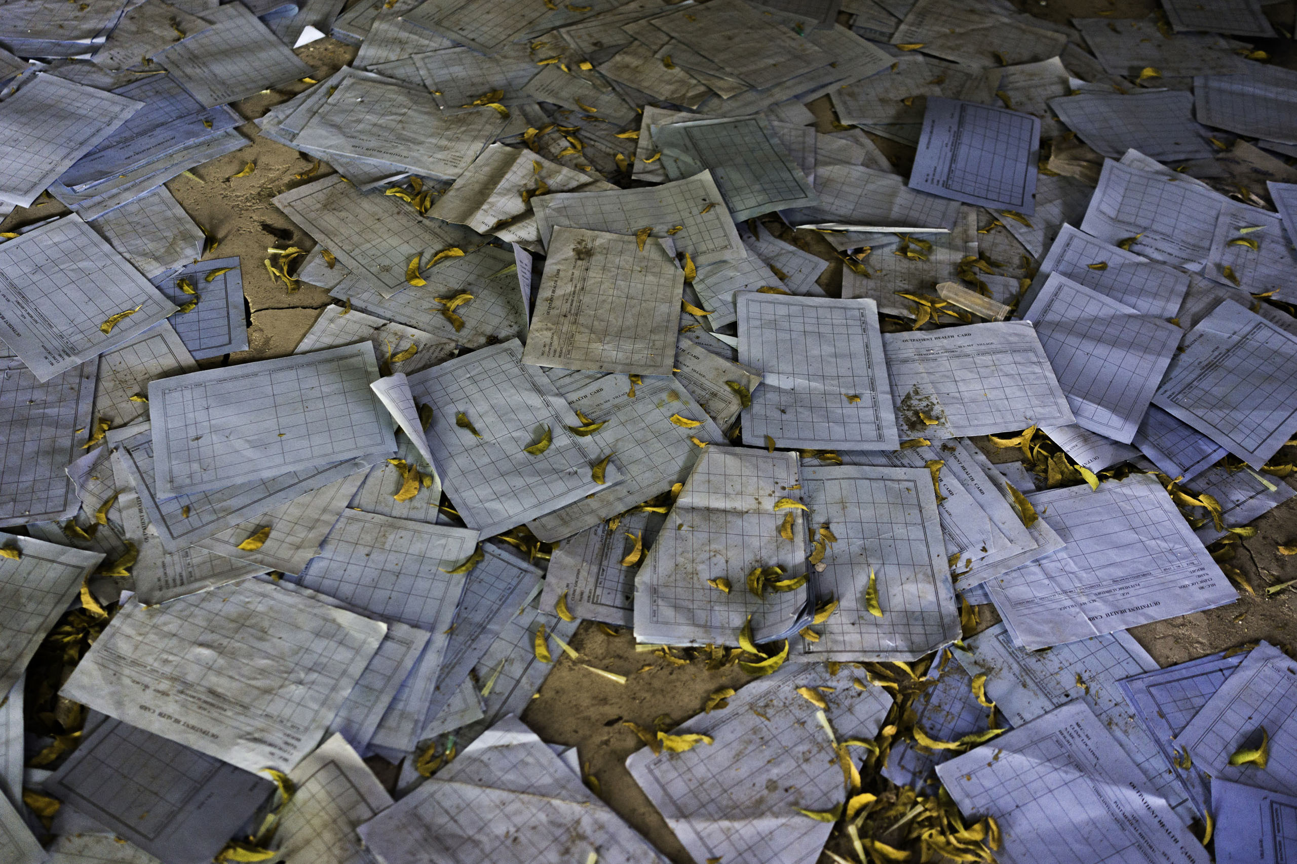 Medical charts are scattered on the ground inside the looted and abandoned Doctors Without Borders hospital in Leer, Unity State, South Sudan.