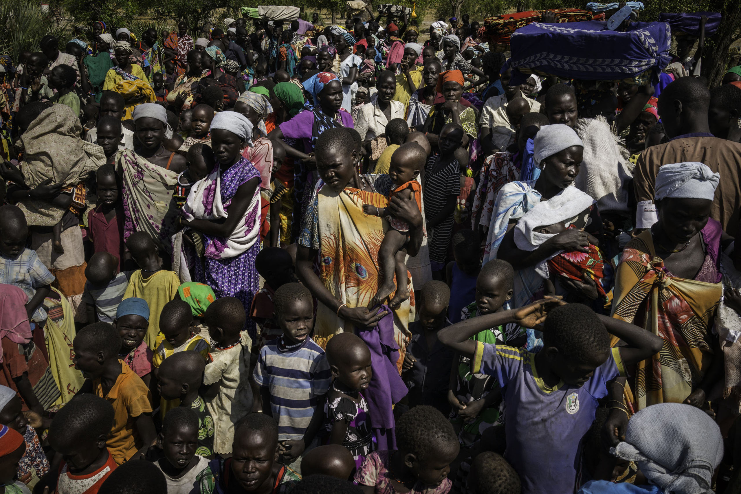 Hundreds of people receive their first distribution of food for malnourished children in Koch, Unity State, South Sudan.