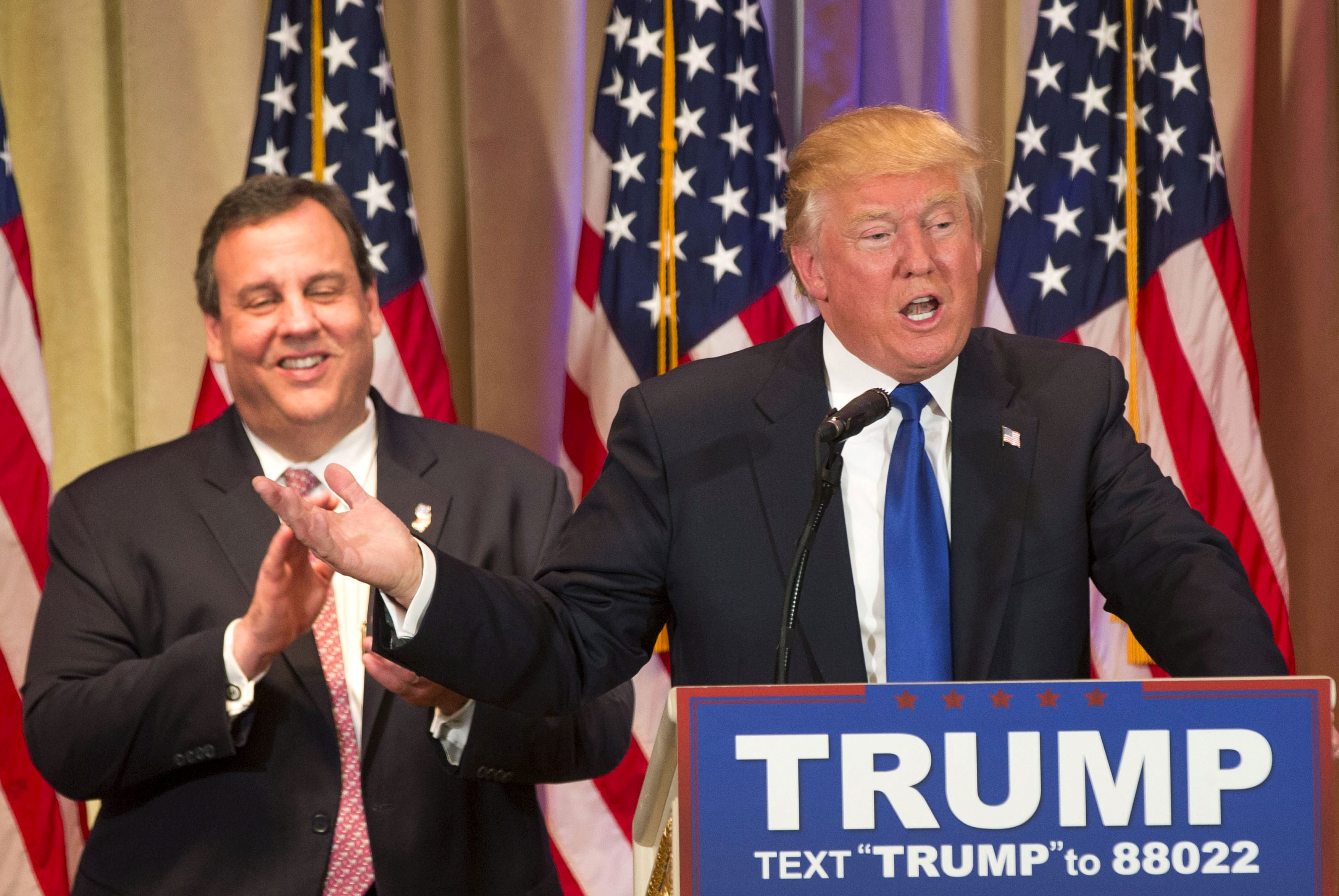 Republican 2016 US presidential candidate businessman Donald Trump (R) speaks, after being introduced by New Jersey Governor Chris Christie (L) at a Super Tuesday campaign event in Palm Beach, Florida, USA, 01 March 2016. The Florida presidential primary is 15 March 2016. EPA/RYAN STONE