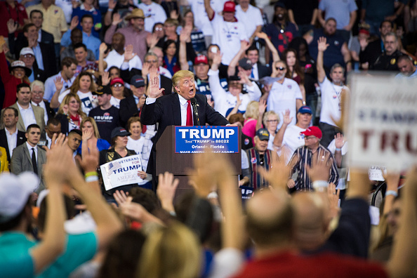 Republican presidential candidate Donald Trump guides everyone to pledge to vote for him as he speaks during a campaign event at the CFE Federal Credit Union Arena in Orlando, FL on March 5.