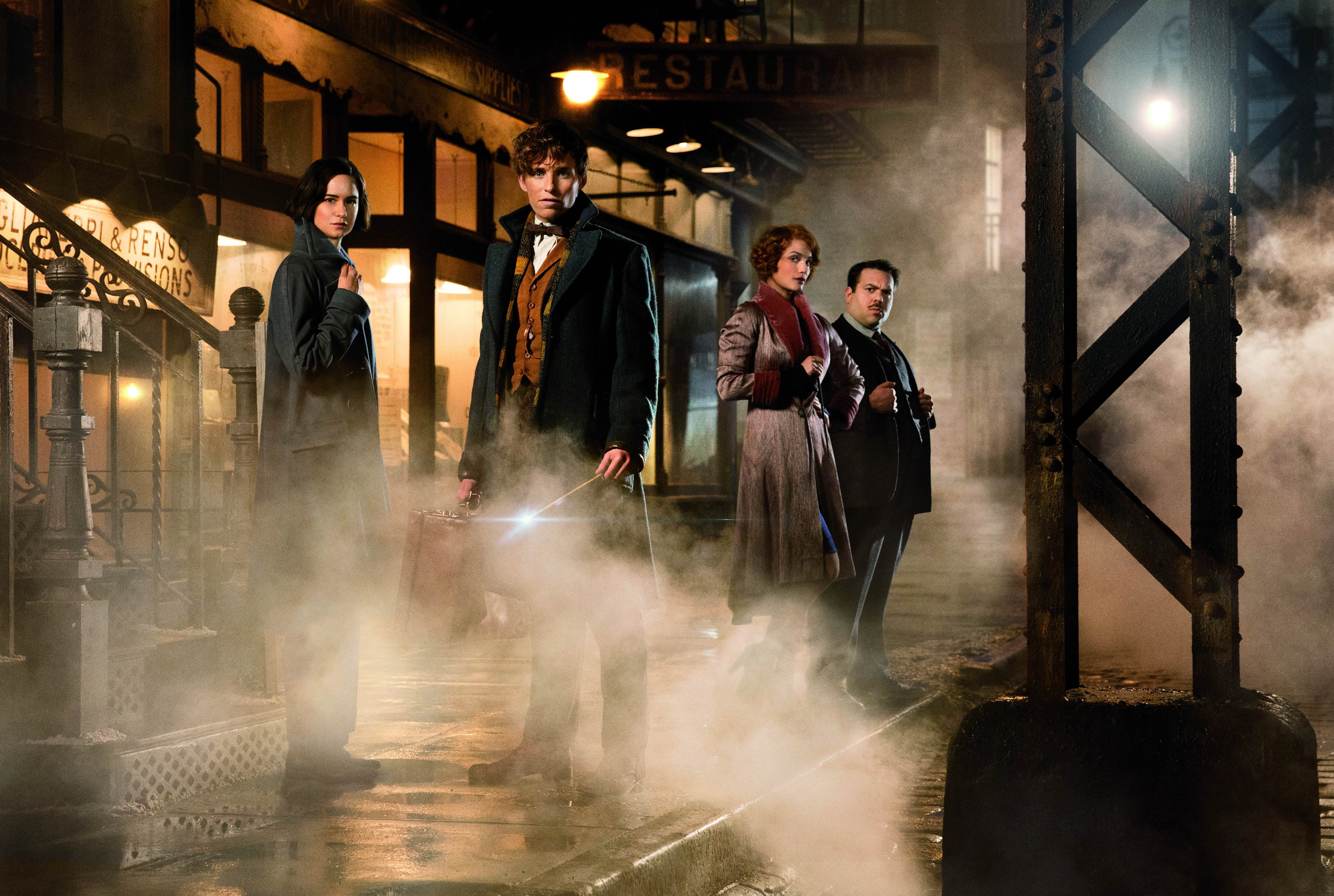 Katherine Waterston as Tina, Eddie Redmayne as Newt Scamander, AIison Sudol as Queenie and Dan Fogler as Jacob in Warner Bros. Pictures' fantasy adventure  Fantastic Beasts and Where to Find Them.