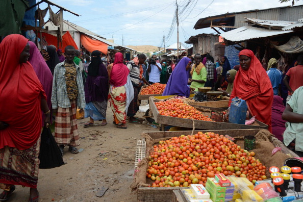 Vendors sell fresh goods at the Karan market, in Somalia's capital of Mogadishu on June 30, 2014 after a bomb exploded. Two people were killed and seven wounded when a bomb exploded on June 30 in a busy market in Somalia's capital Mogadishu at the start of Islam's holy month of Ramadan, police said. There was no immediate claim of responsibility, but Somalia's Al-Qaeda linked Shebab have carried out a string of similar bombings, and have vowed to increase attacks during the fasting month of Ramadan. AFP PHOTO/MOHAMED ABDIWAHAB        (Photo credit should read Mohamed Abdiwahab/AFP/Getty Images)