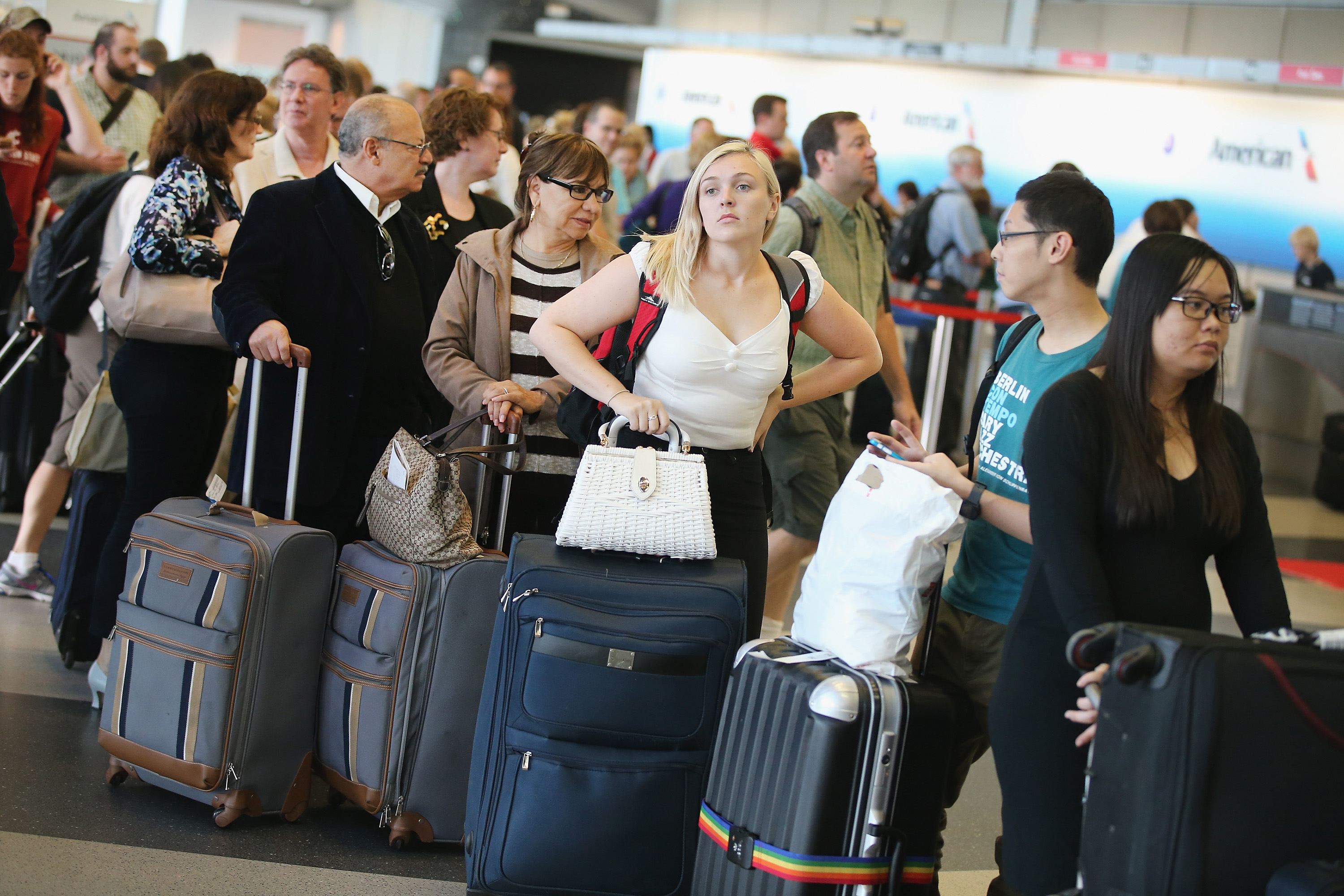 Passengers wait in line to reschedule flights at O'Hare International Airport on September 26, 2014 in Chicago, Illinois.