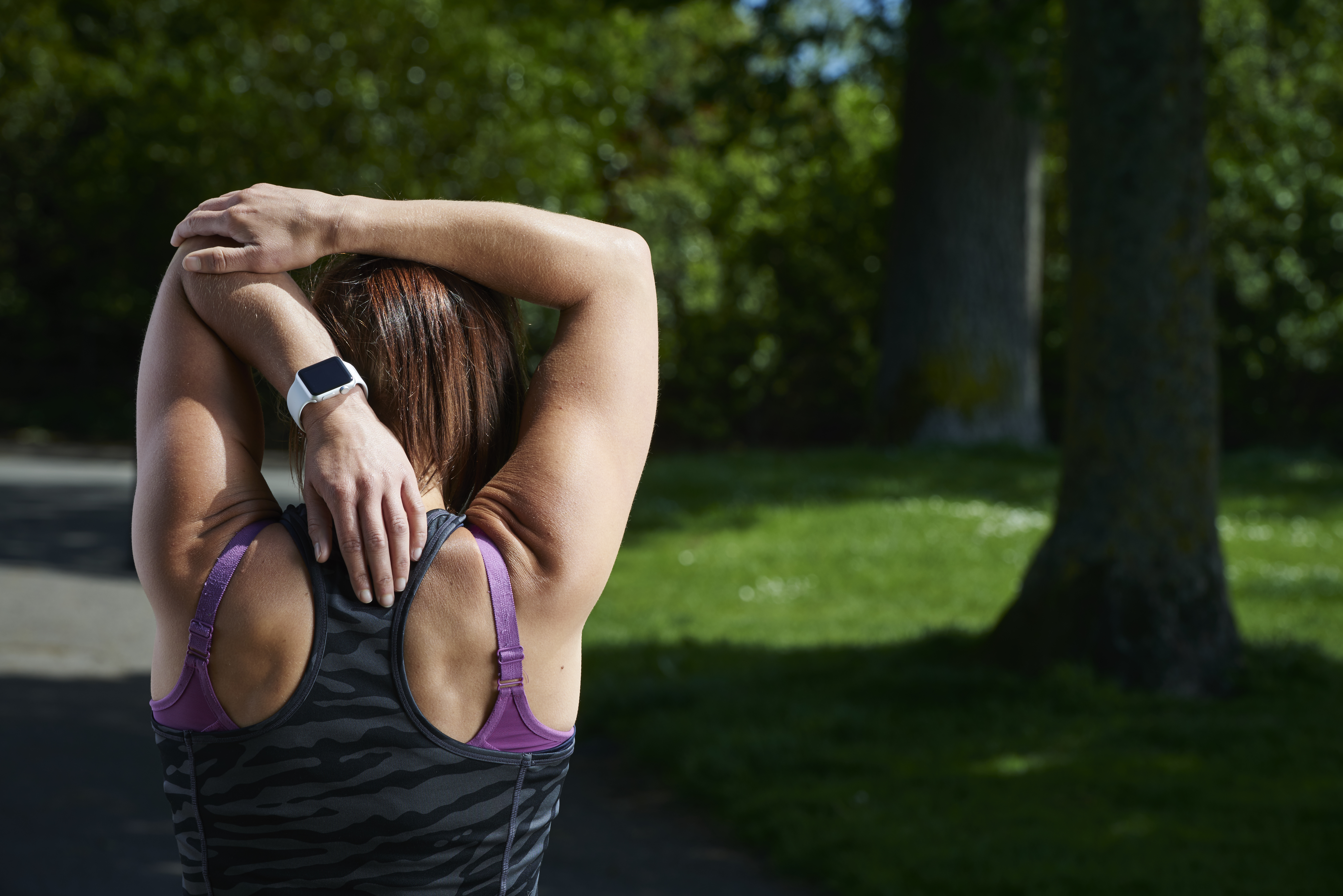 Woman running with an Apple Watch.