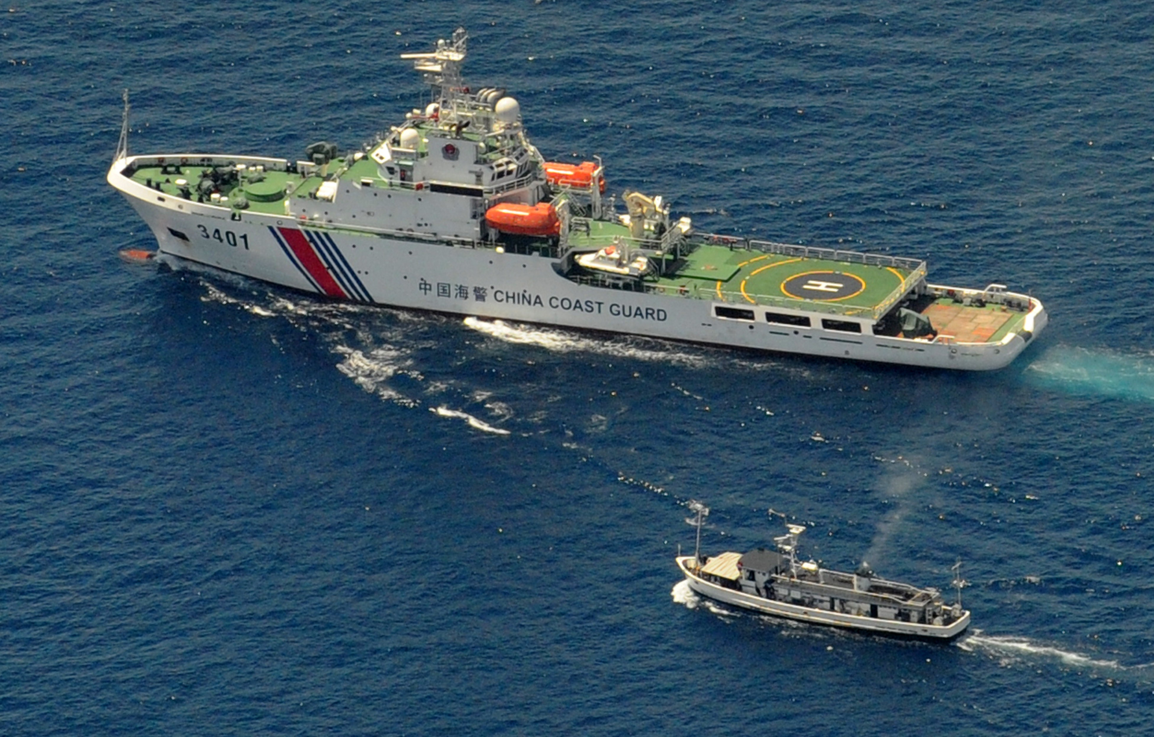 A China Coast Guard ship and a Philippine supply boat engage in a standoff as the Philippine boat attempts to reach the Second Thomas Shoal, a remote South China Sea reef claimed by both countries, on March 29, 2014