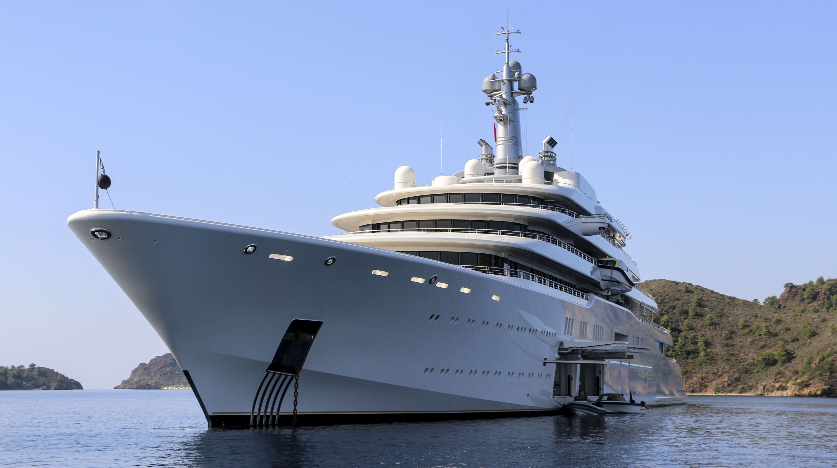 Eclipse, the private luxury yacht of Russian billionaire Roman Abramovich, anchors at Hisaronu Bay in Marmaris district of Mugla, southwestern Turkey on October 19, 2015. The 163-meter-long Eclipse, world's second largest private yacht, has two helicopter pads, 24 guest cabins, two swimming pools, a disco hall, a movie theater and two mini-submarines.