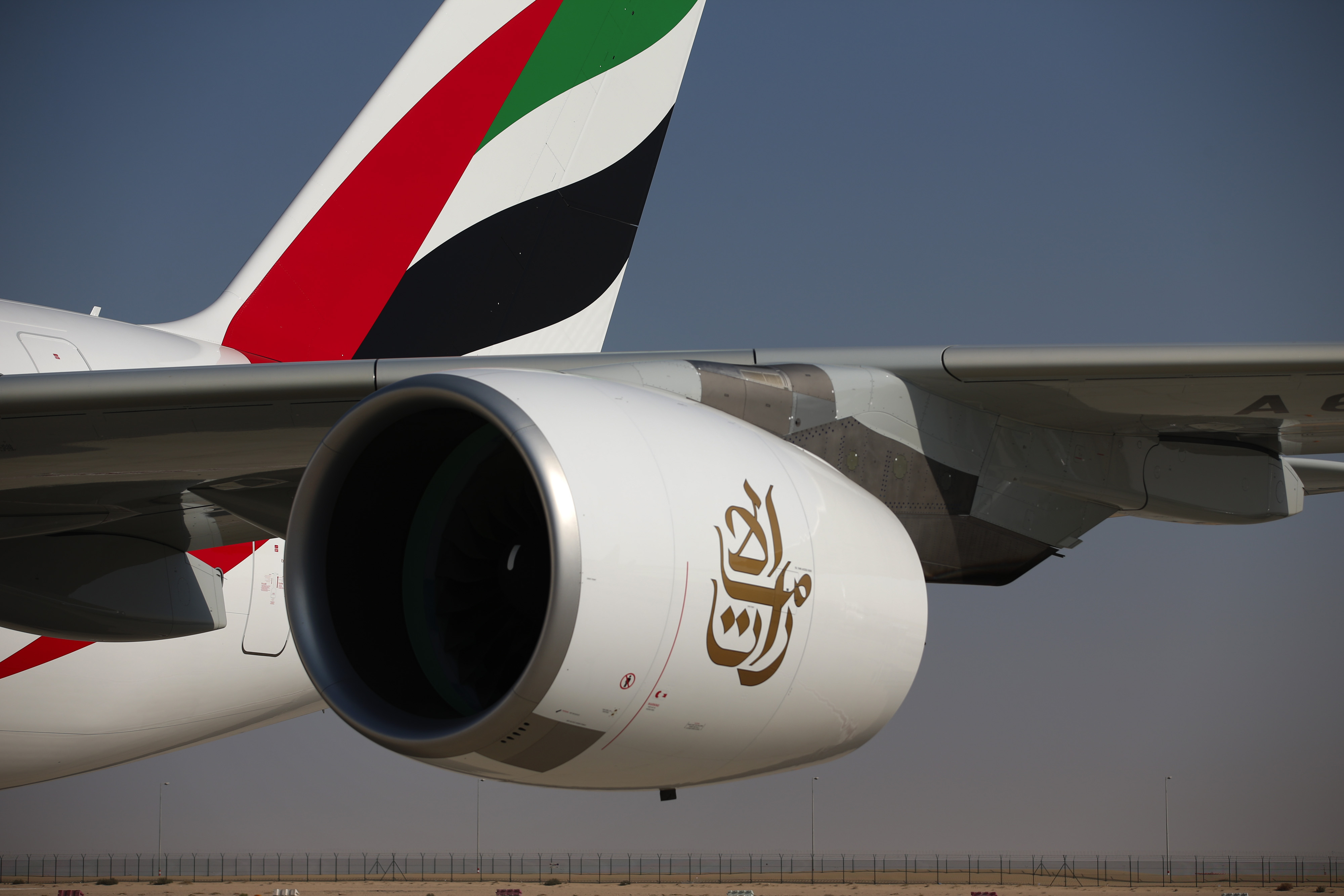 The engine of an Airbus SAS A380-800 aircraft hangs from the wing of an Emirates Airline aircraft on the opening day of the 14th Dubai Air Show in Dubai on Nov. 8, 2015