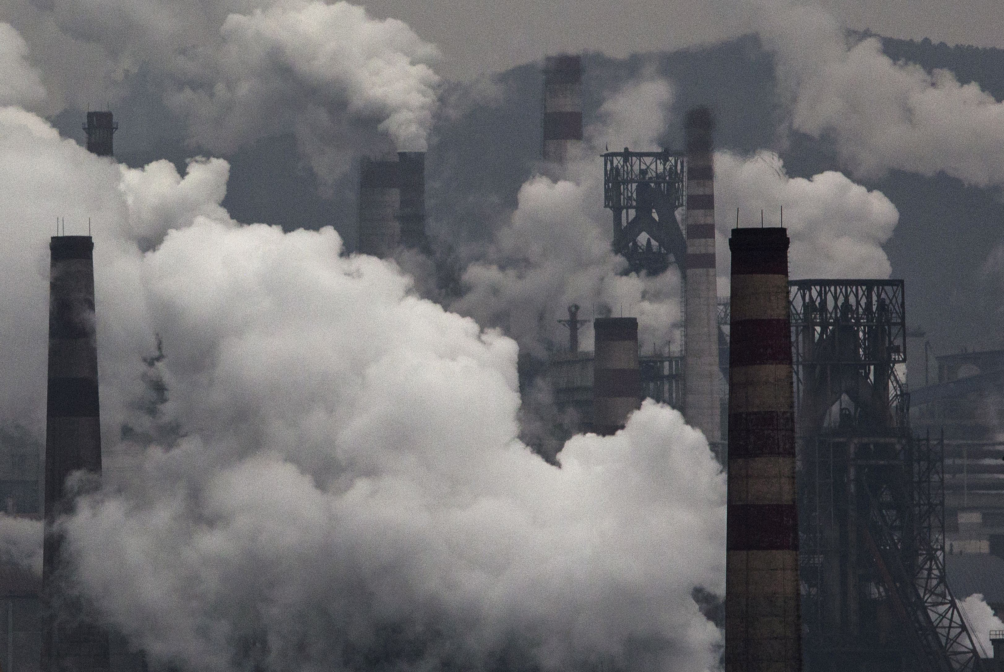Smoke billows from smokestacks and a coal-fired generator at a steel factory on Nov. 19, 2015, in China's industrial province of Hebei