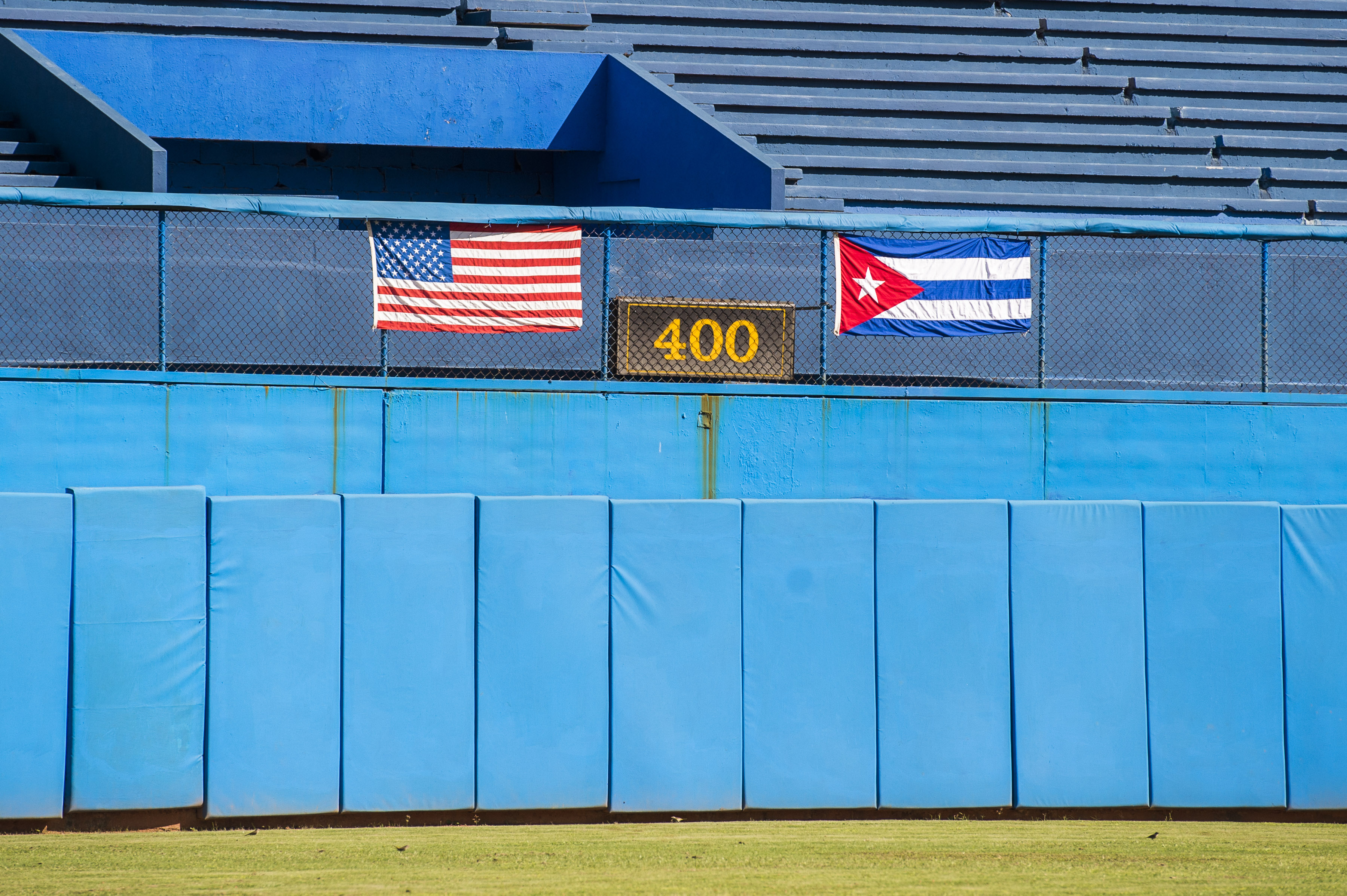 An American flag and Cuban flag are seen in Estadio Latinoamericano during an MLB goodwill tour on Tuesday, Dec. 16, 2015 in Havana, Cuba