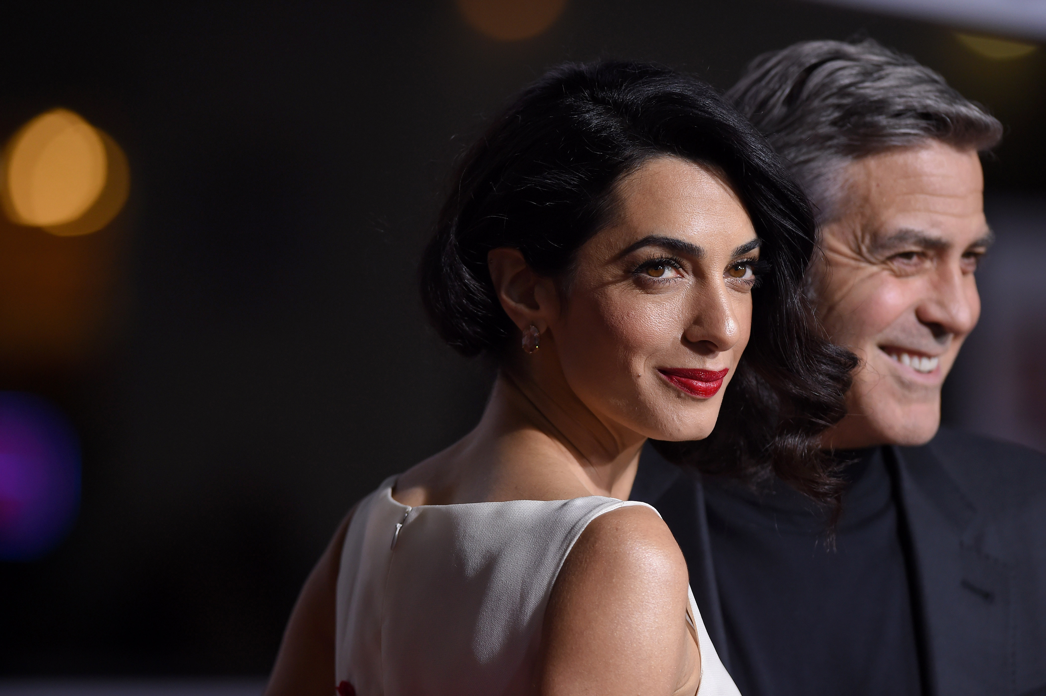Lawyer Amal Clooney and actor George Clooney arrive at the premiere of Hail, Caesar! at Regency Village Theatre on Feb. 1, 2016, in Westwood, Calif.