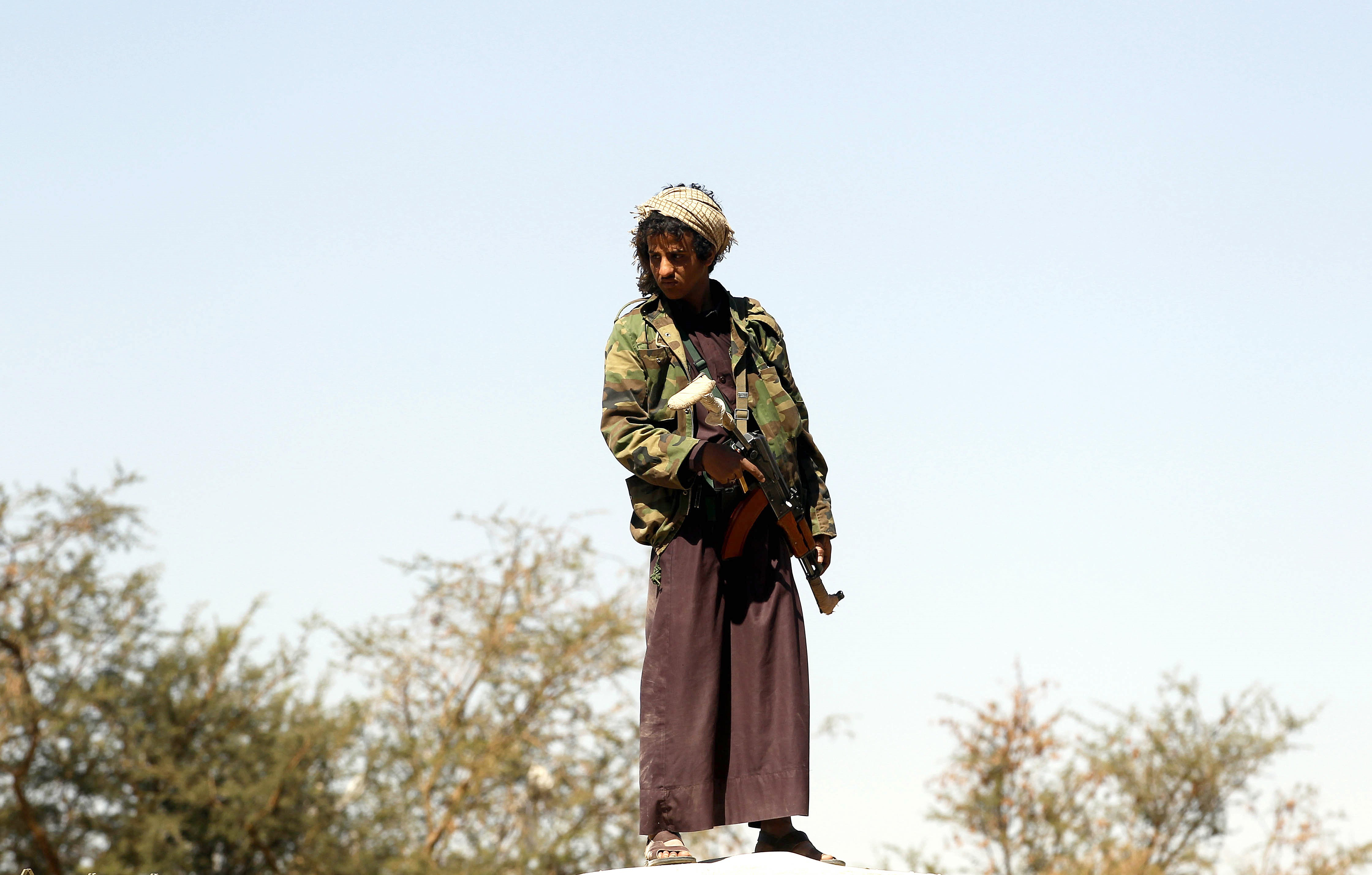 A member of Houthi Ansarullah movement stands guard during the funeral ceremony of Latif al Khahum, a member of Houthi Ansarullah Movement, at al-Jaraf neighbourhood in Sanaa, Yemen on Feb.18, 2016