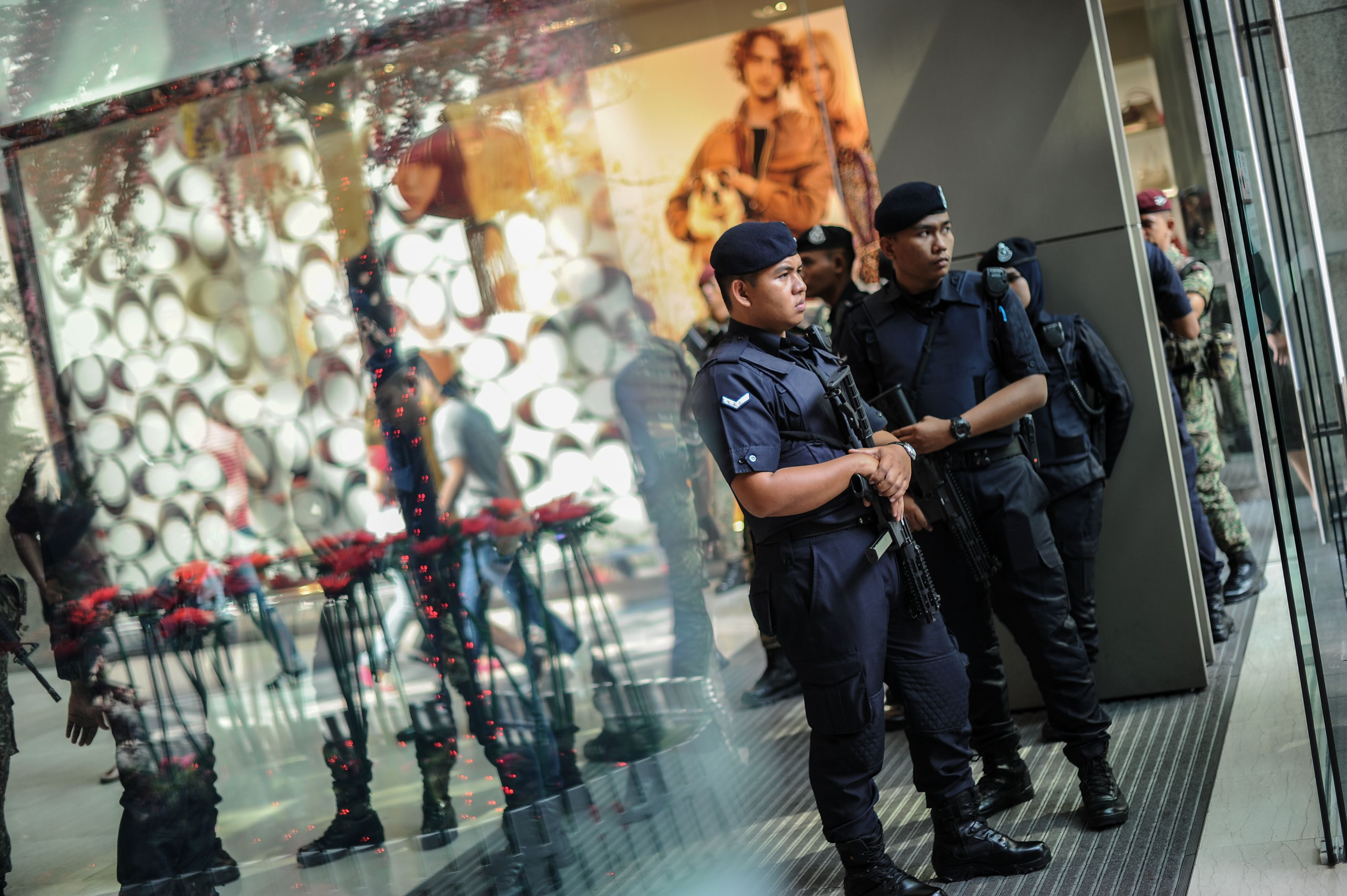 Malaysian police stand guard before the arrival of Prime Minister Najib Razak during a joint police-army exercise at a shopping mall in Kuala Lumpur on Feb. 22, 2016