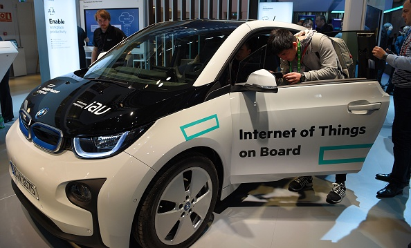 Visitors test a car with internet conection during on the second day of the Mobile World Congress in Barcelona on February 23, 2016.                                              The world's biggest mobile fair, held from February 22 to February 25. / AFP / LLUIS GENE        (Photo credit should read LLUIS GENE/AFP/Getty Images)