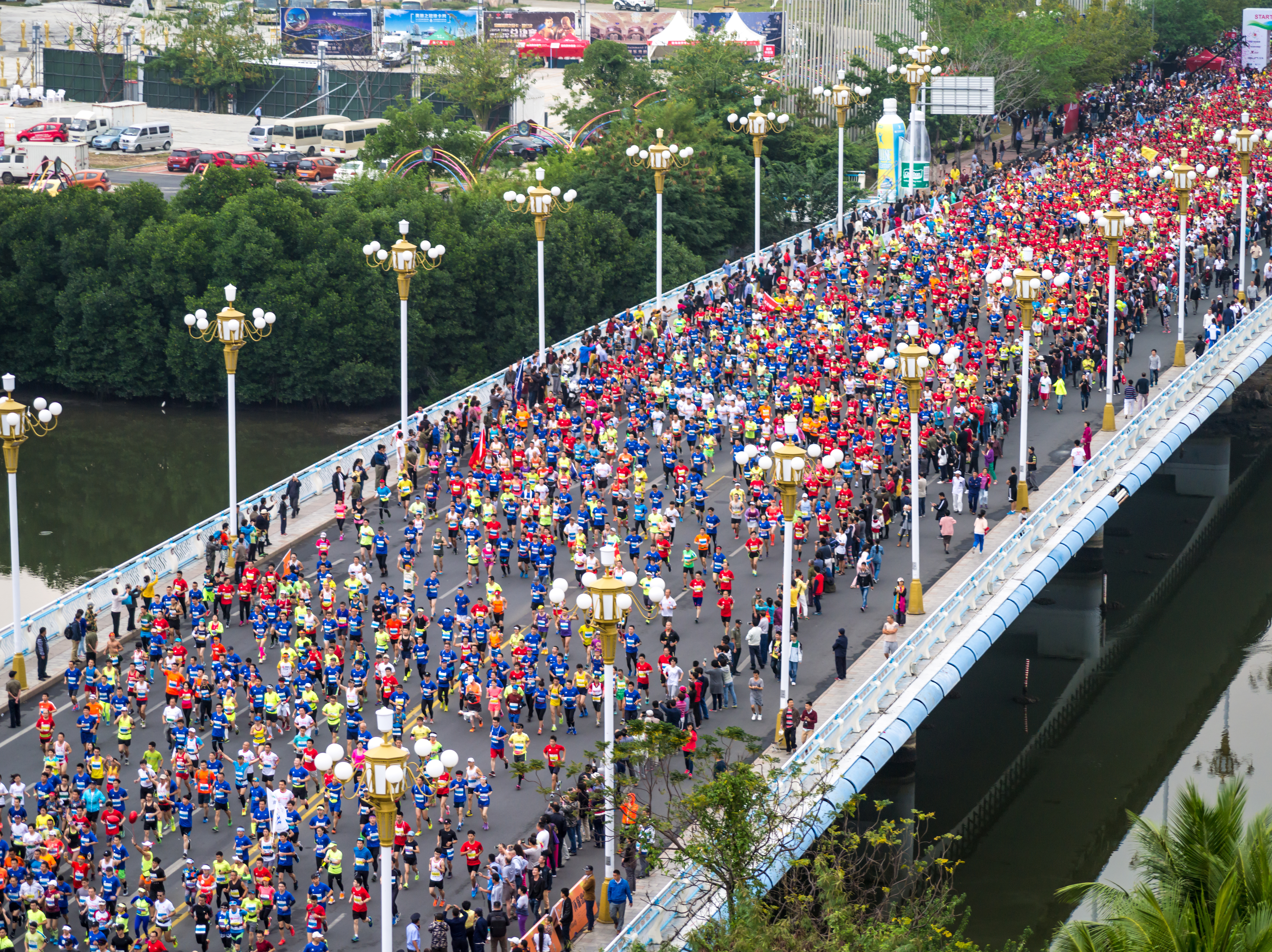 Participants run during the 2016 Hainan International Marathon on February 28, 2016 in Sanya, Hainan Province of China.